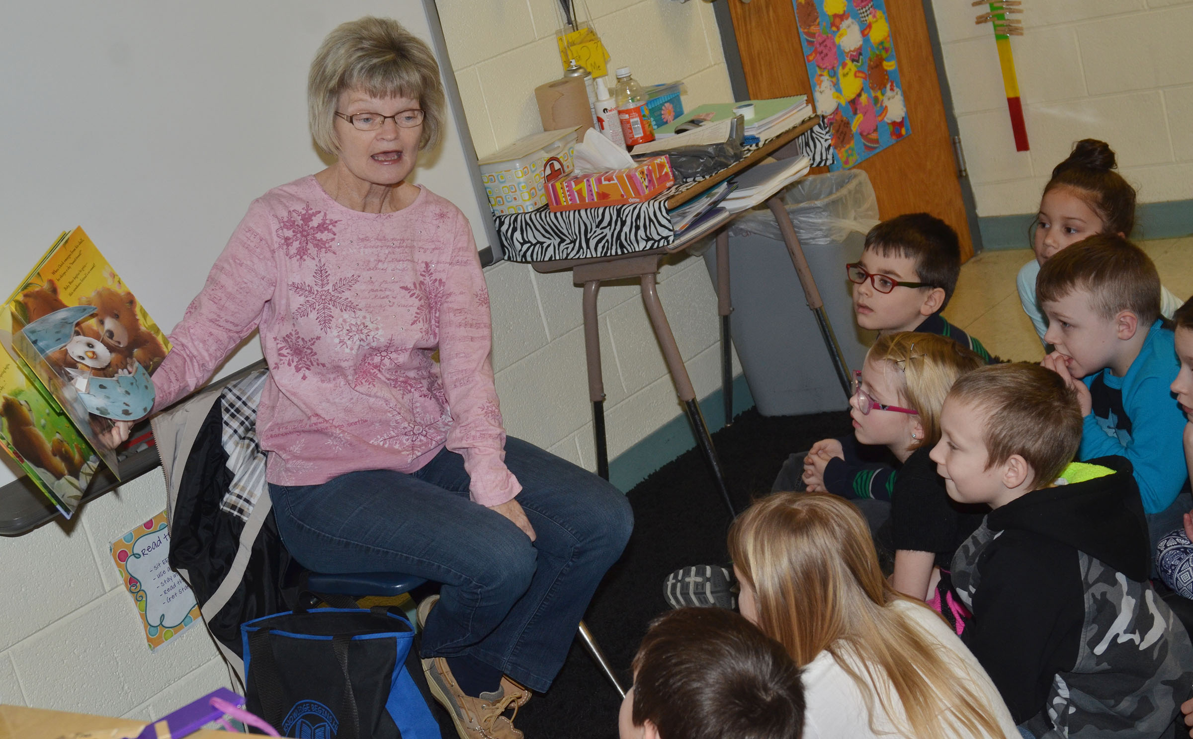 Bonnie Webster reads to CES first-graders.