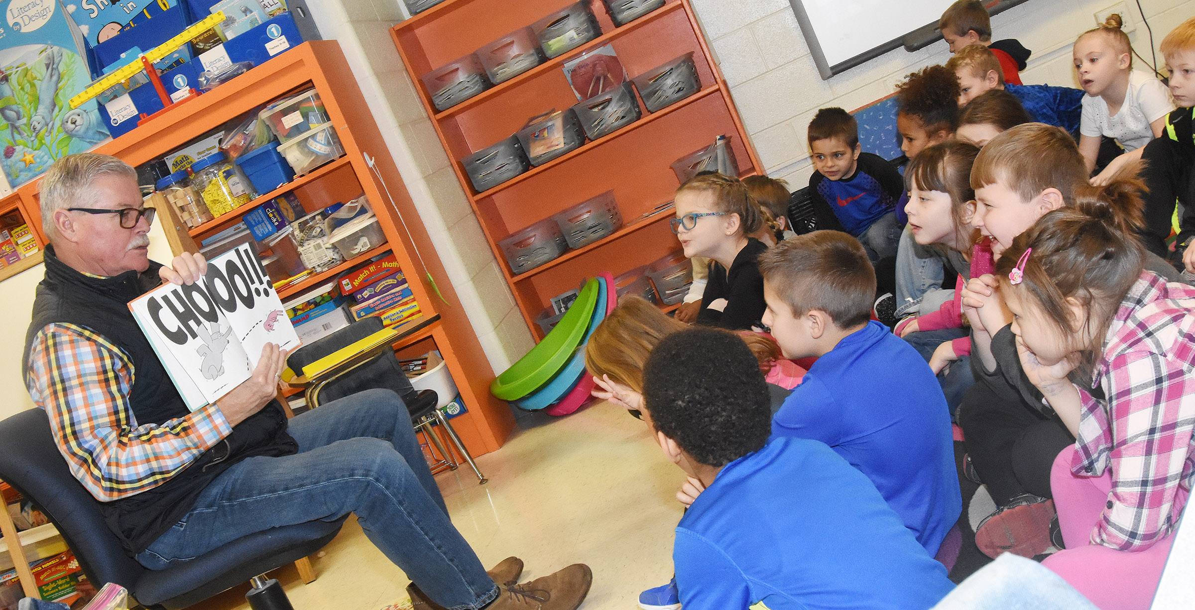 George Wise reads to CES first-graders.