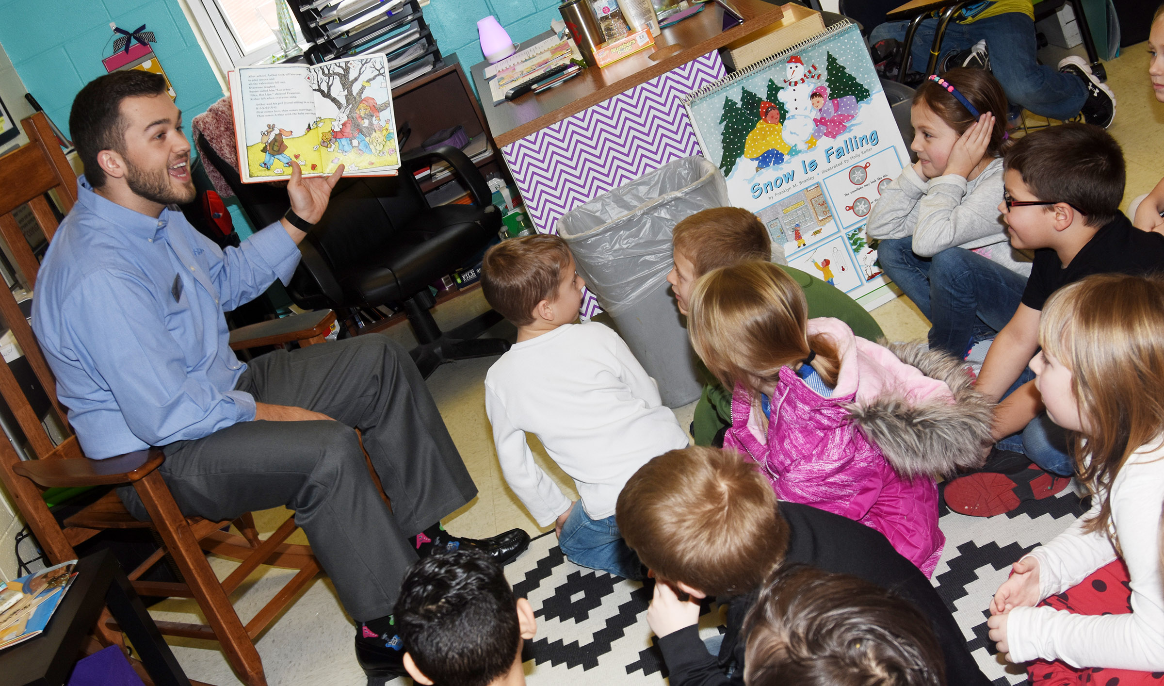 John Eastridge reads to CES first-graders.