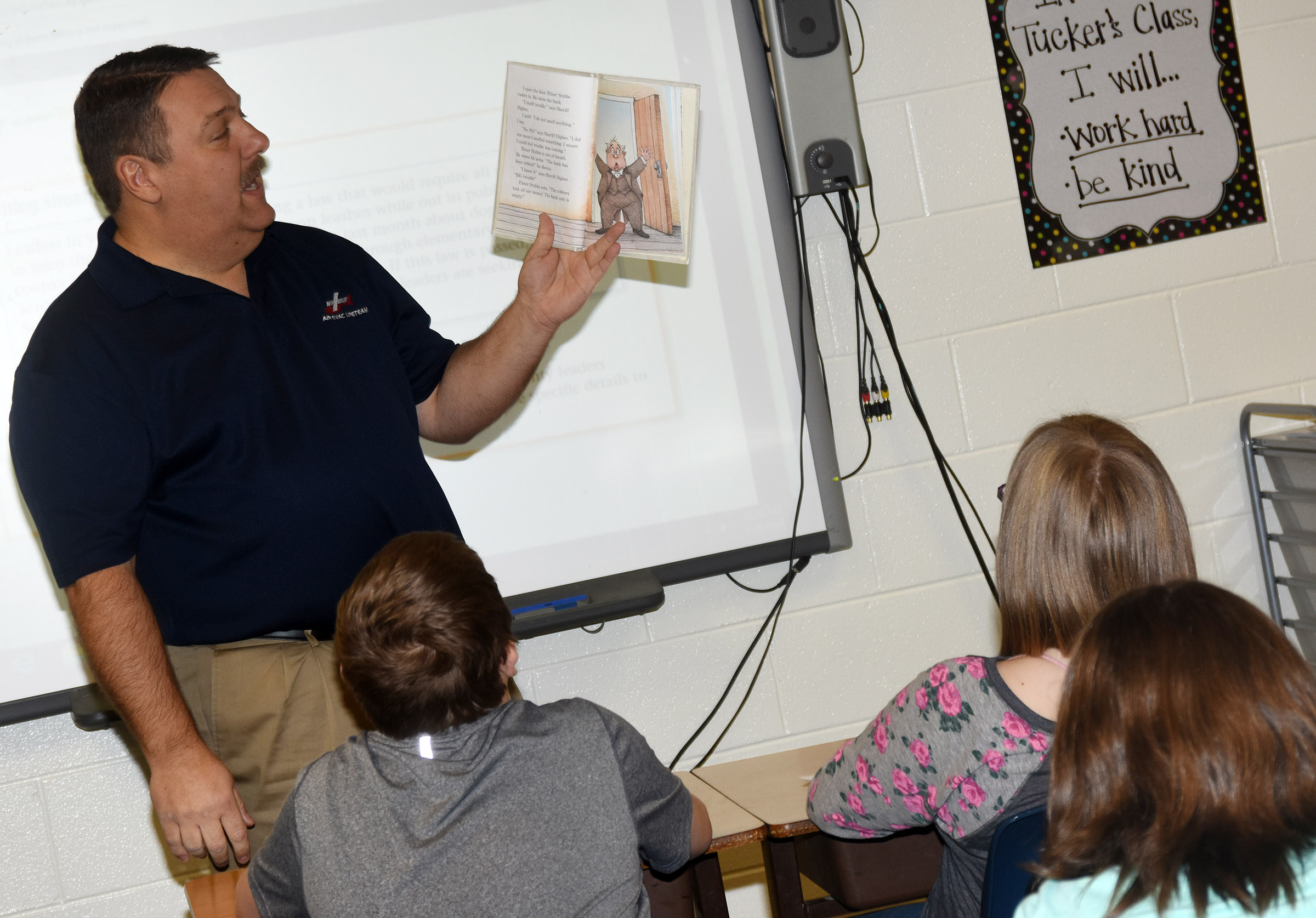 Dan Durham reads to CES fifth-graders.