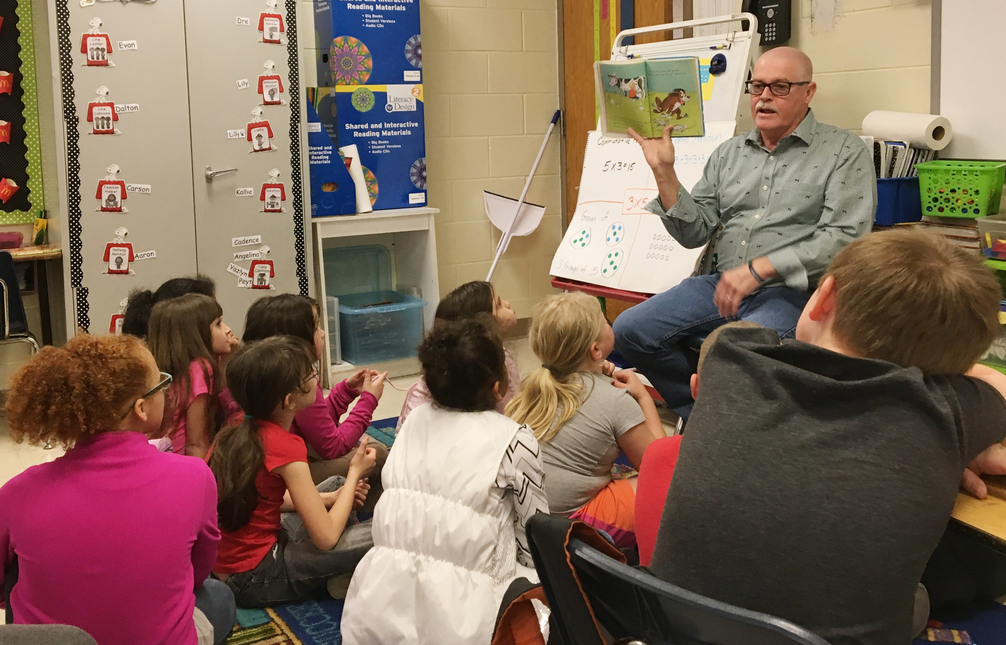 George Wise reads to CES second-graders.