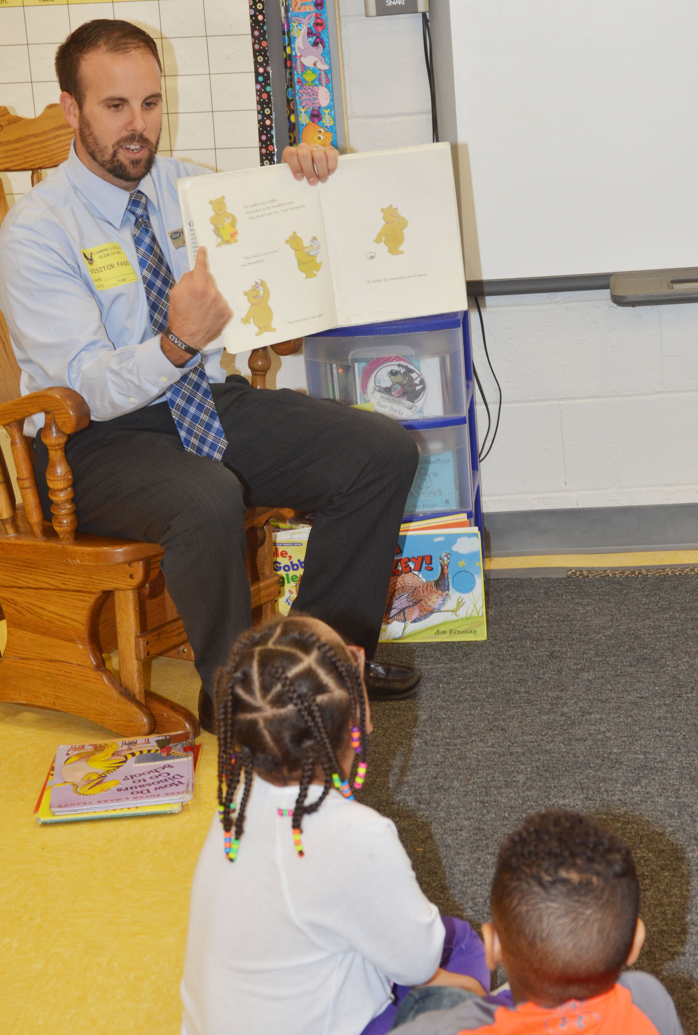 Josh Myers reads to CES preschool students.