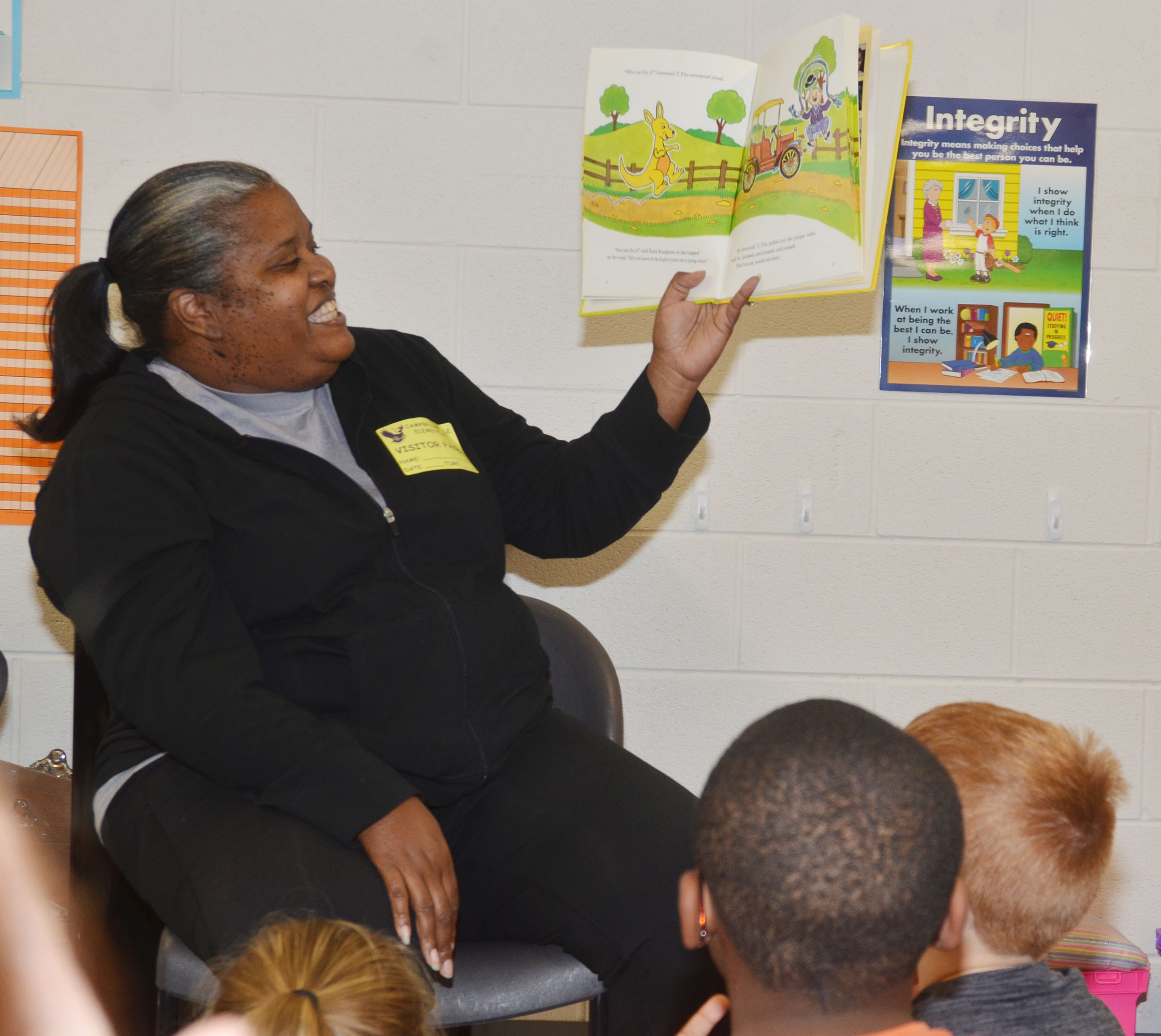 Rosalind Strong reads to CES third-grade students.
