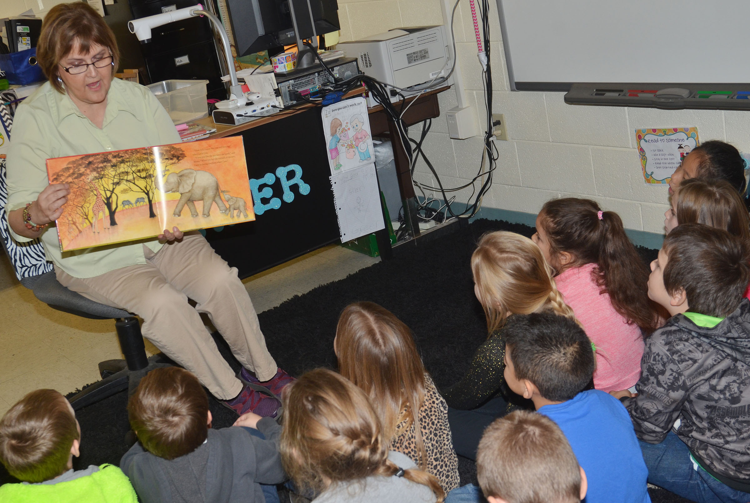 Debbie Edwards reads to CES first-graders.