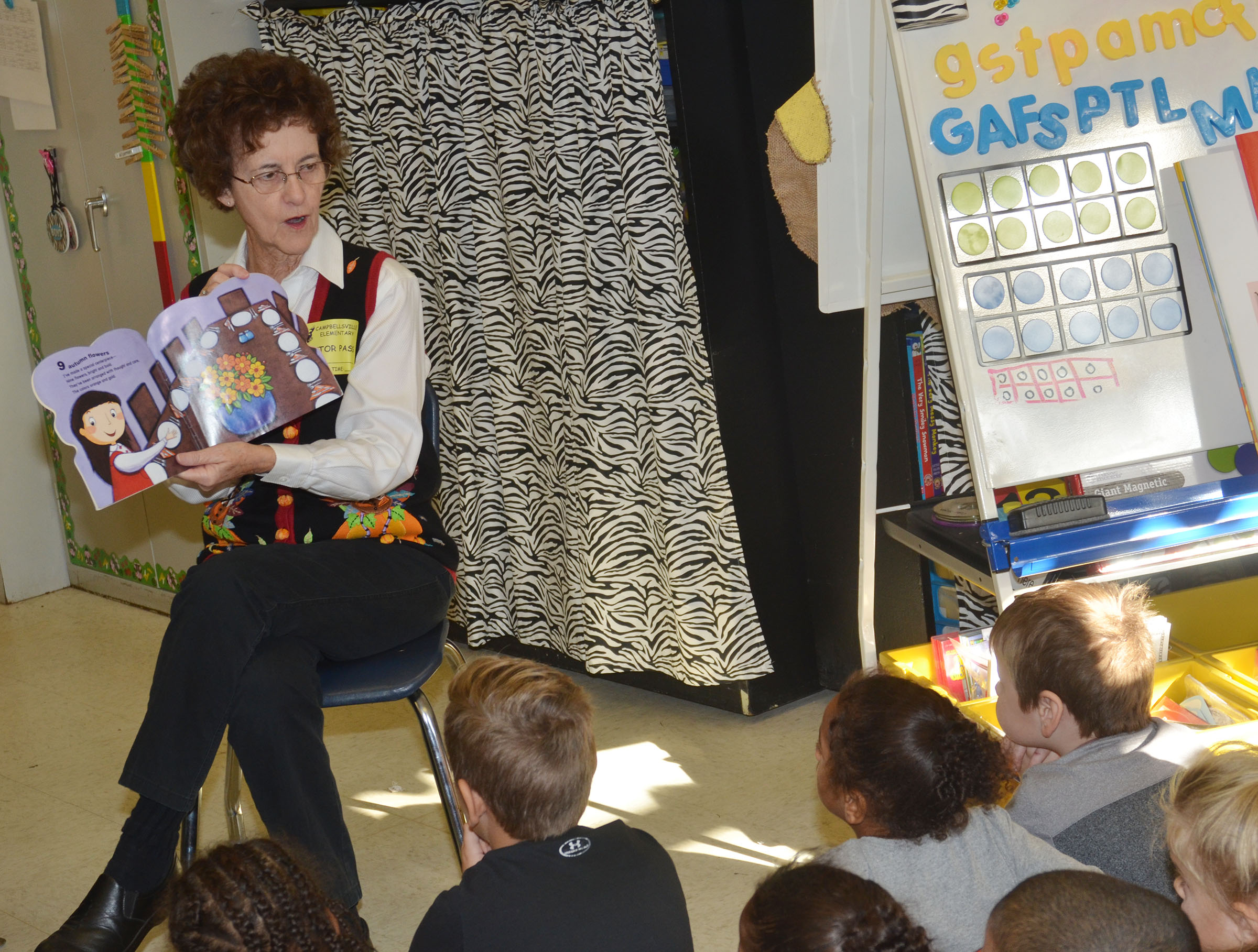 Betty Schuhmann reads to CES kindergarteners.
