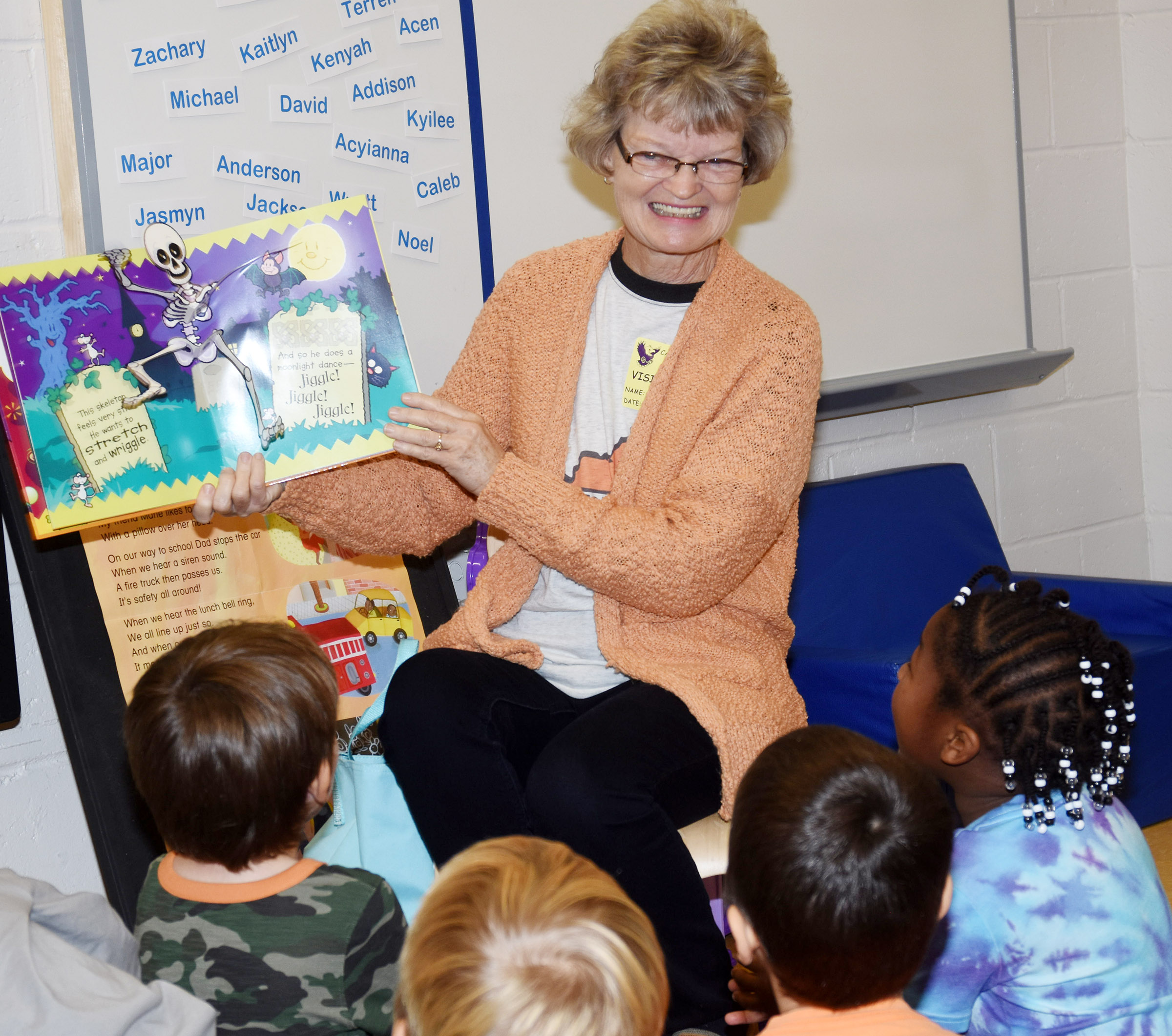 Bonnie Webster reads to CES preschool students.