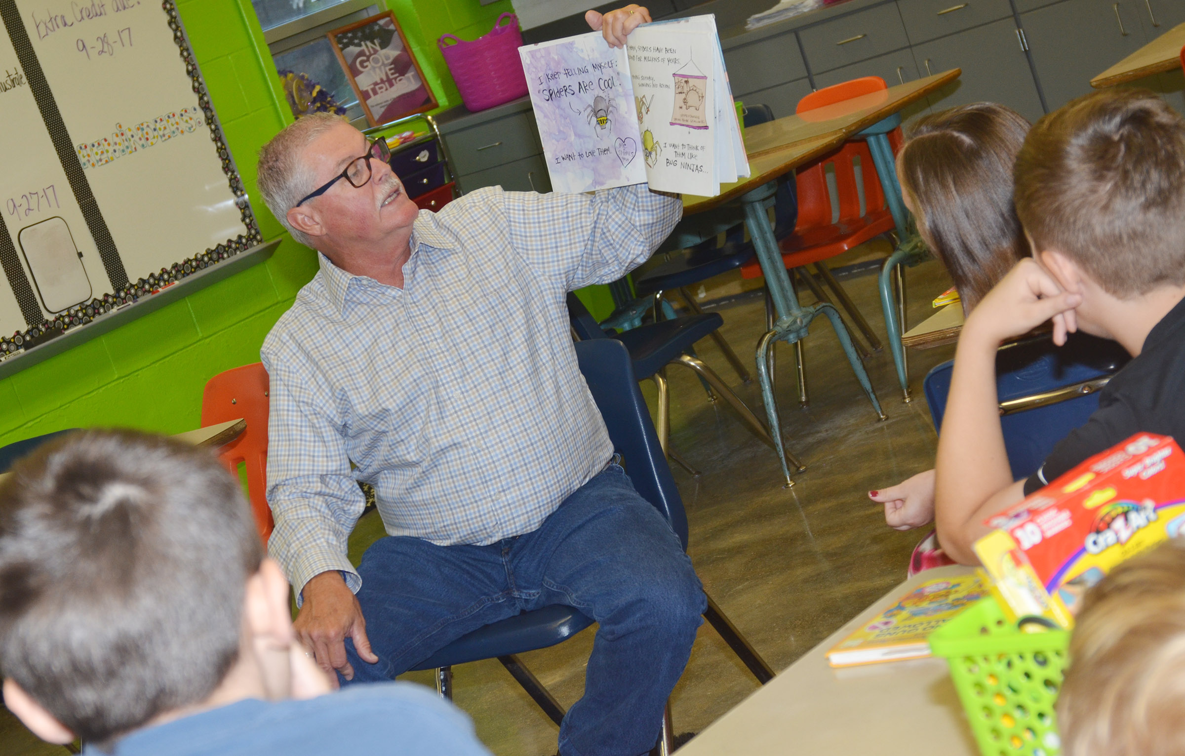 George Wise reads to CES fifth-graders.