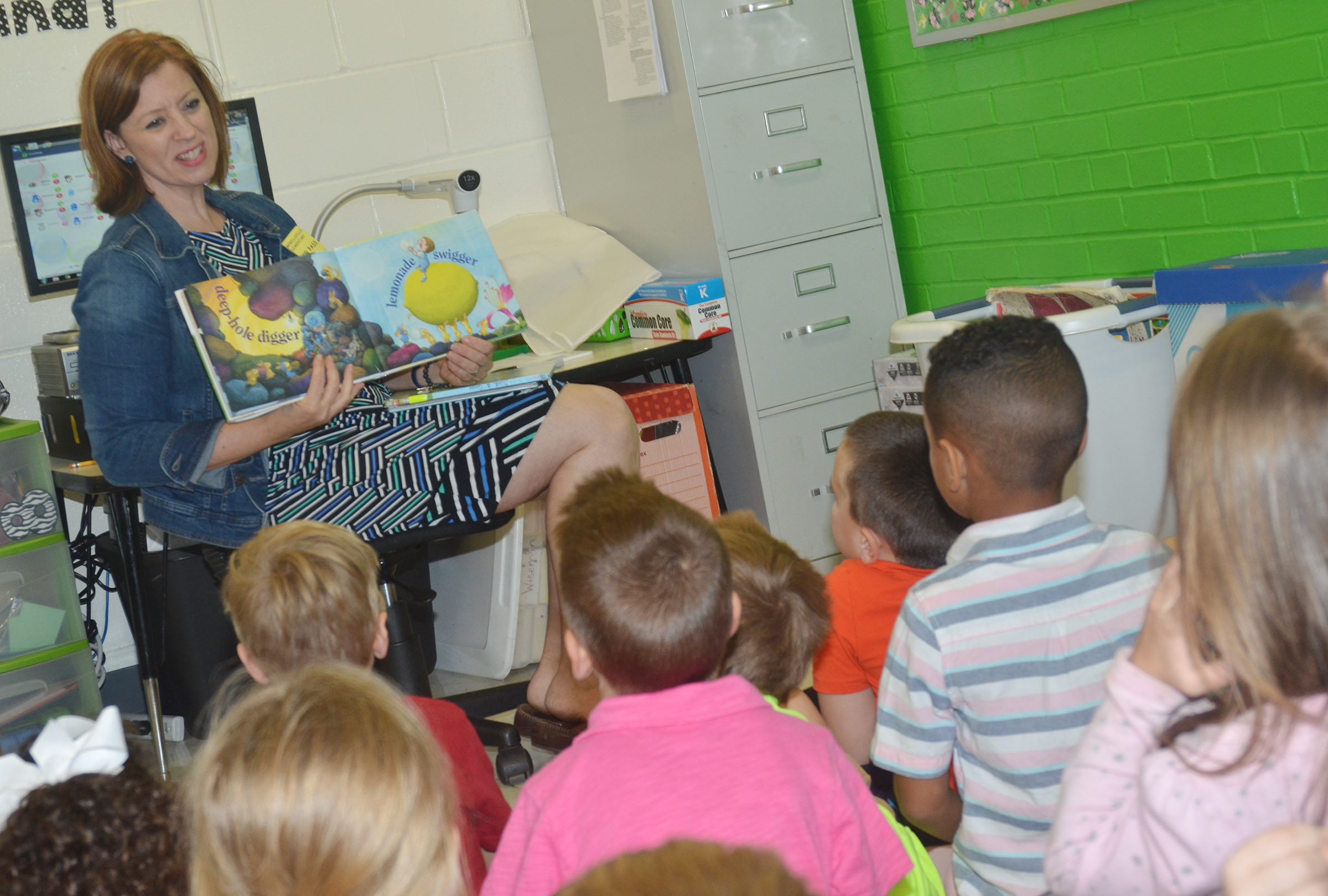 Tammy Sexton reads to CES kindergarteners.