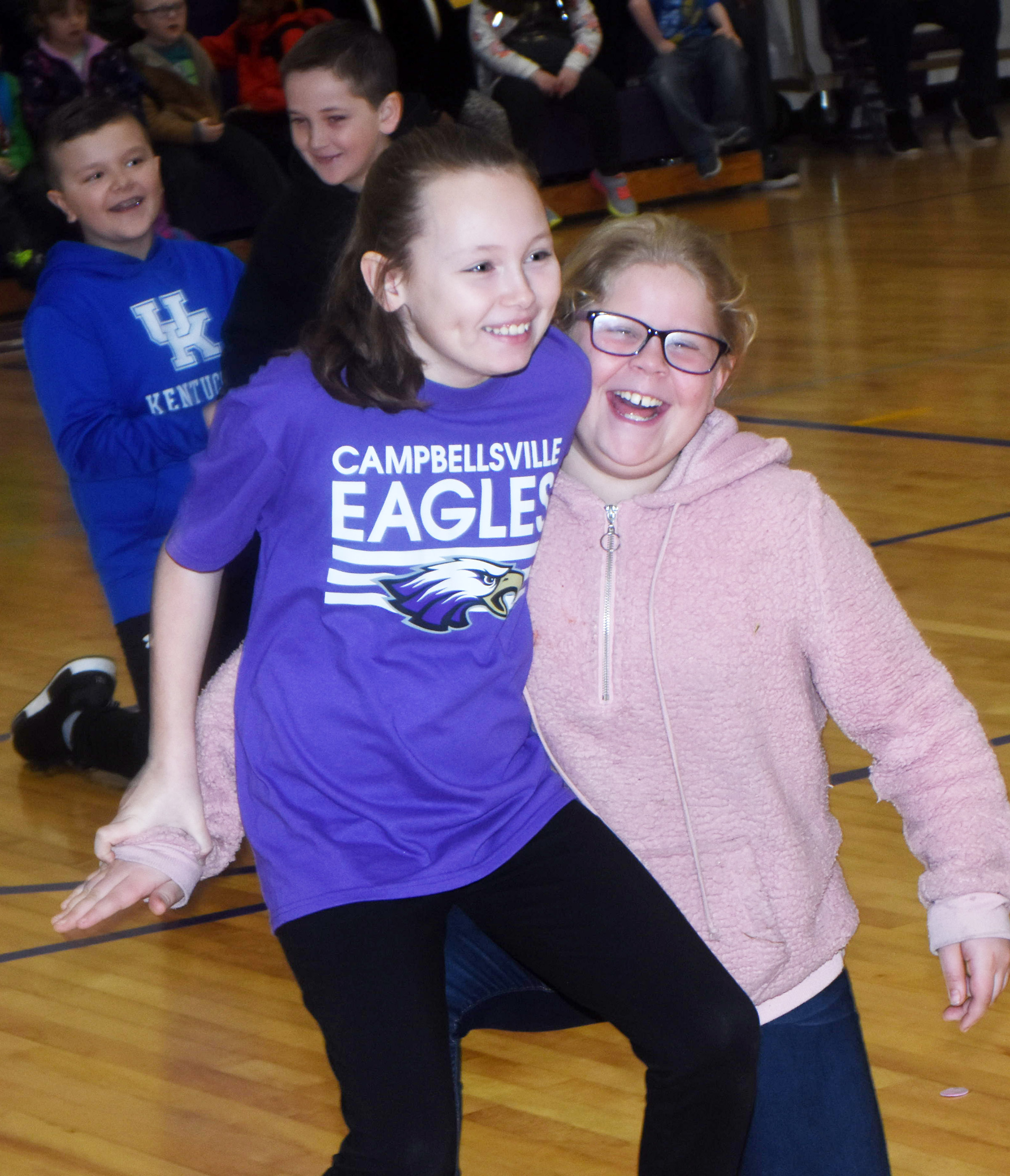 CES fourth-graders River McFarland, at left, and Lily Coots compete in the furniture game.