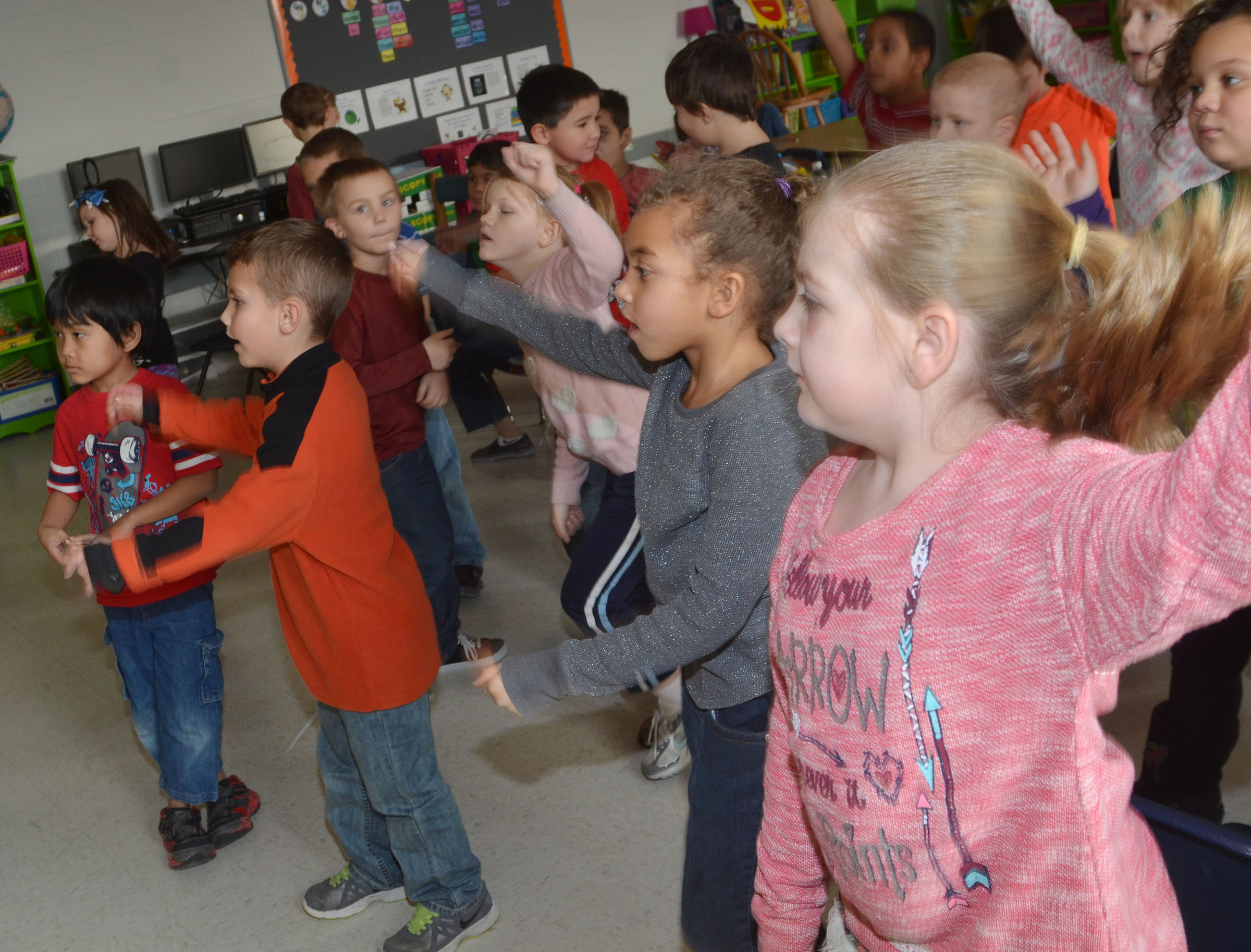 CES first-graders practice counting to 100 while getting a workout.
