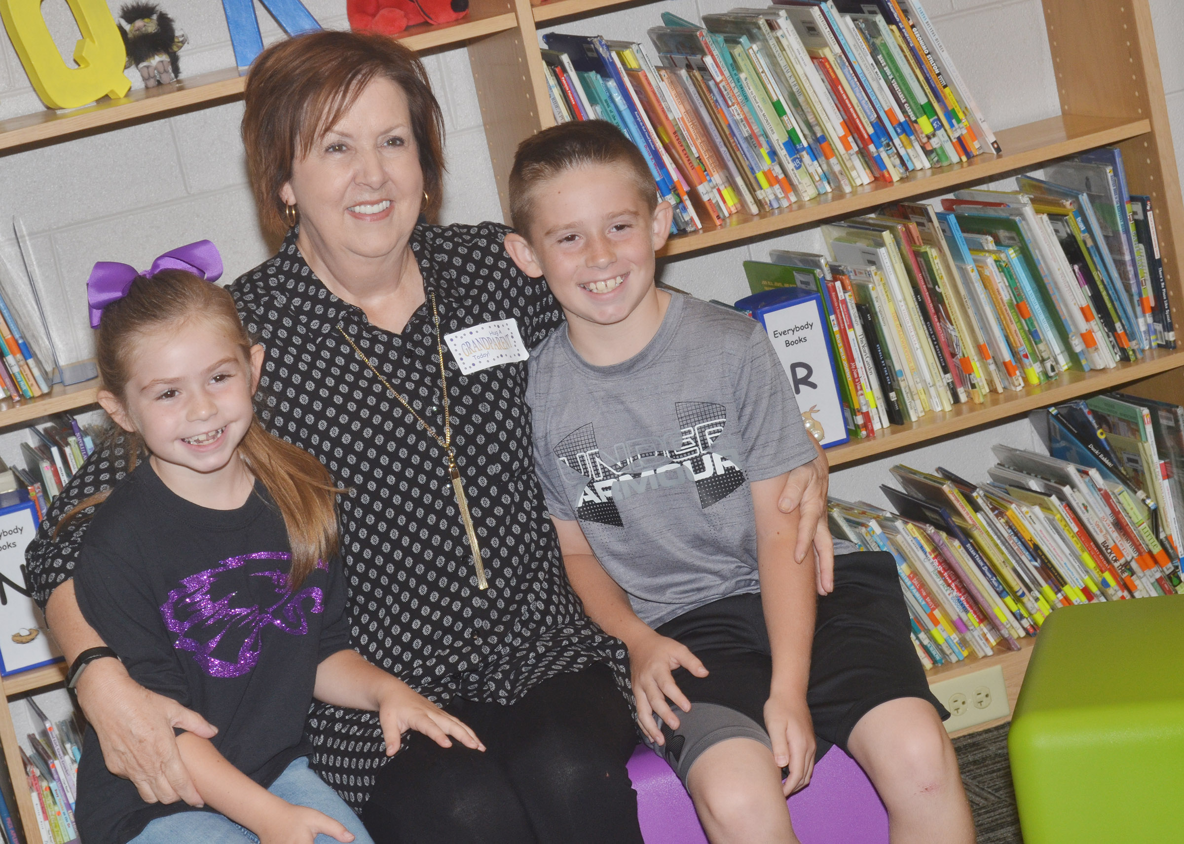 CES second-grader Lainey Price, at left, and third-grader Lanigan Price pose for a photo with their grandmother.