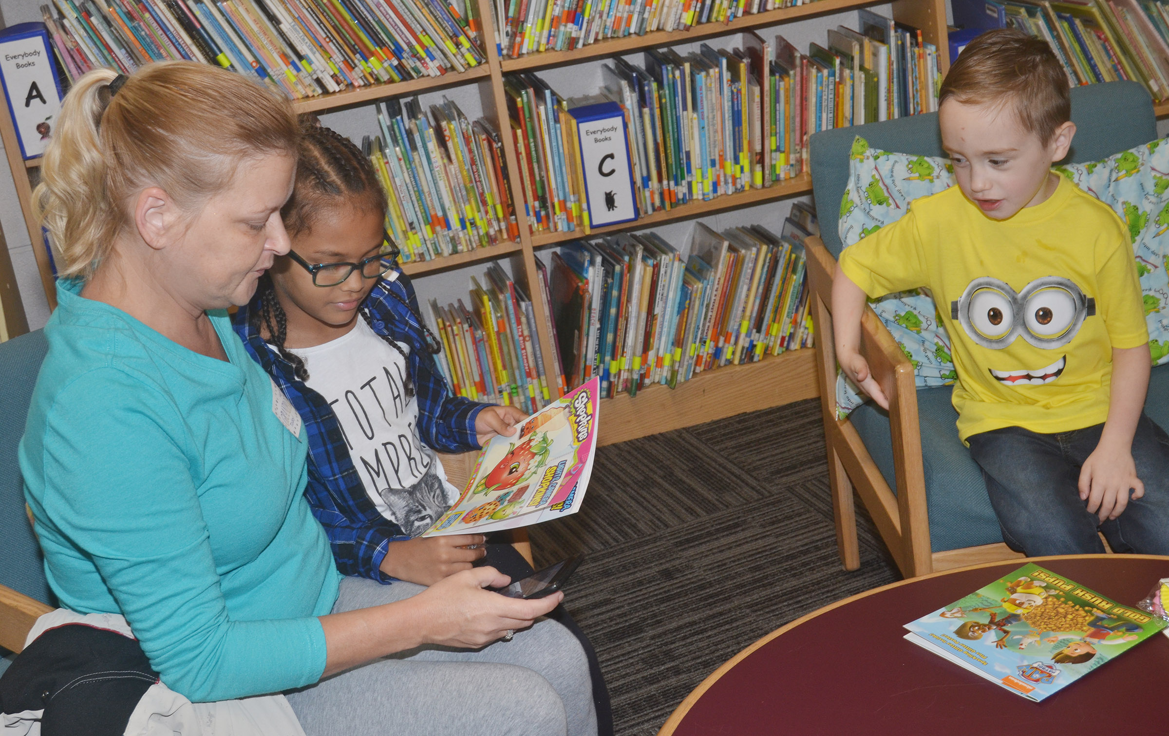 CES first-grader Marlee Dickens, at left, and kindergartener Joshua Dickens read with their grandmother.
