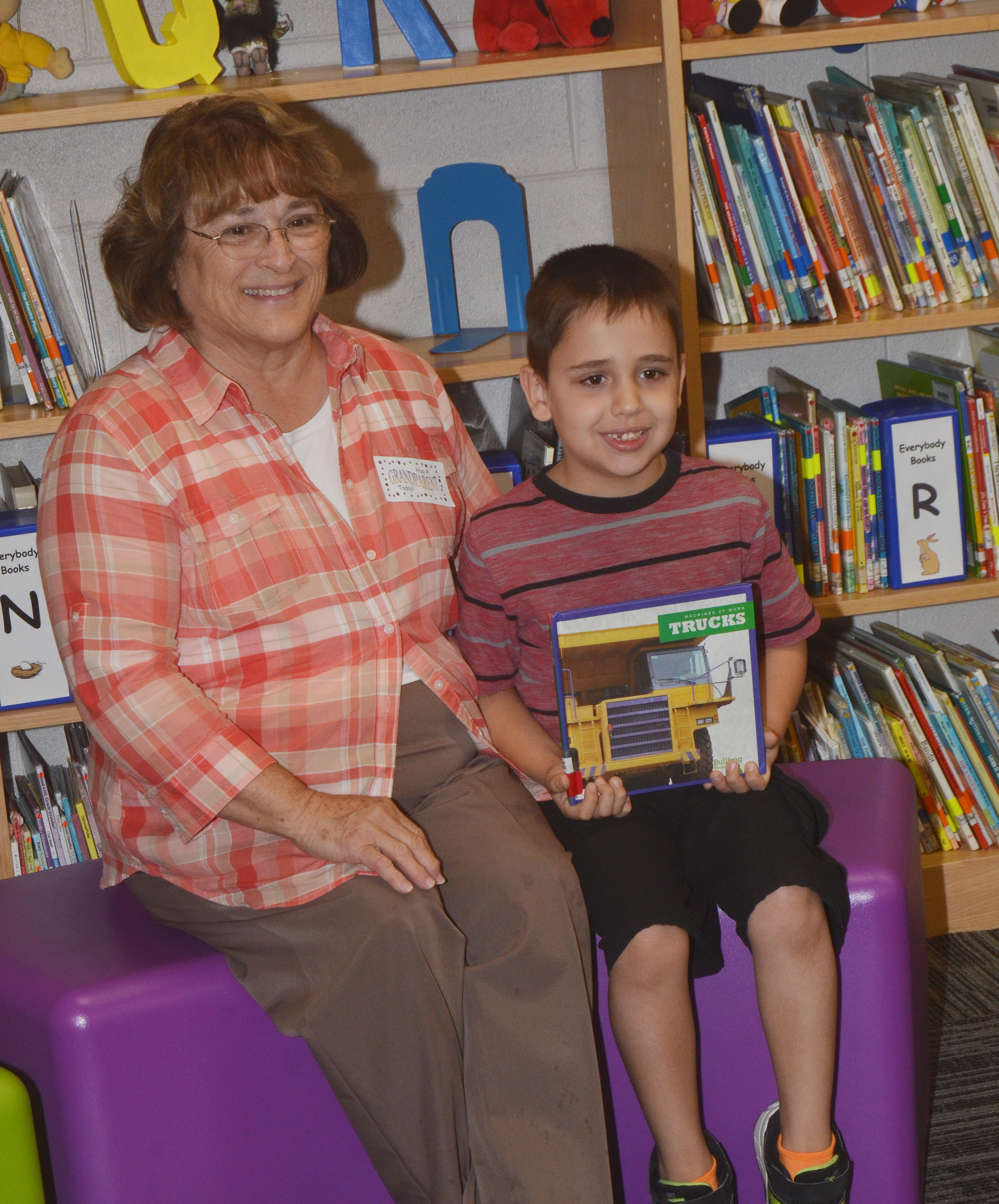 CES second-grader Aaron Floyd poses for a photo with his grandmother.