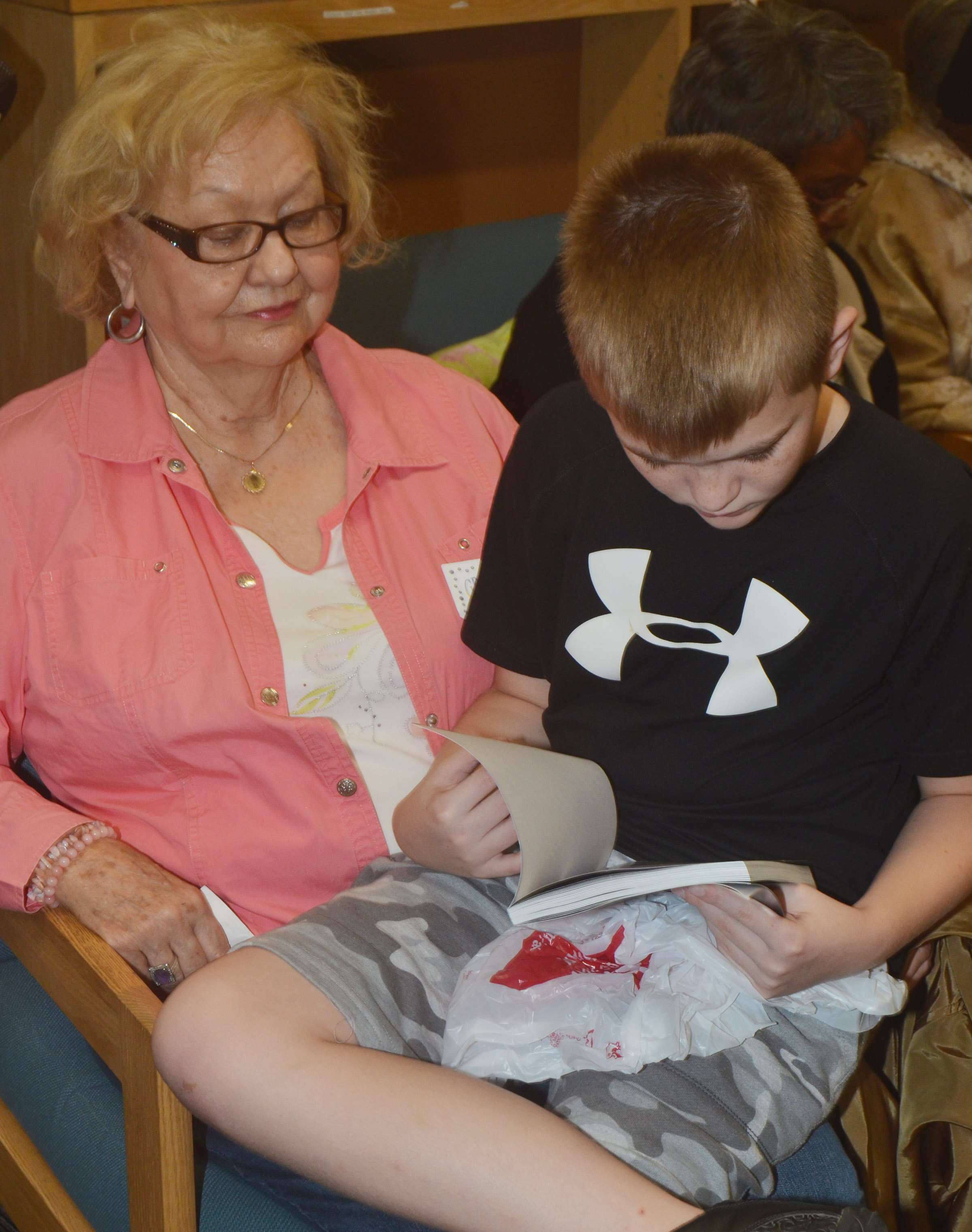 CES fourth-grader Cash Cowan reads with his grandmother.