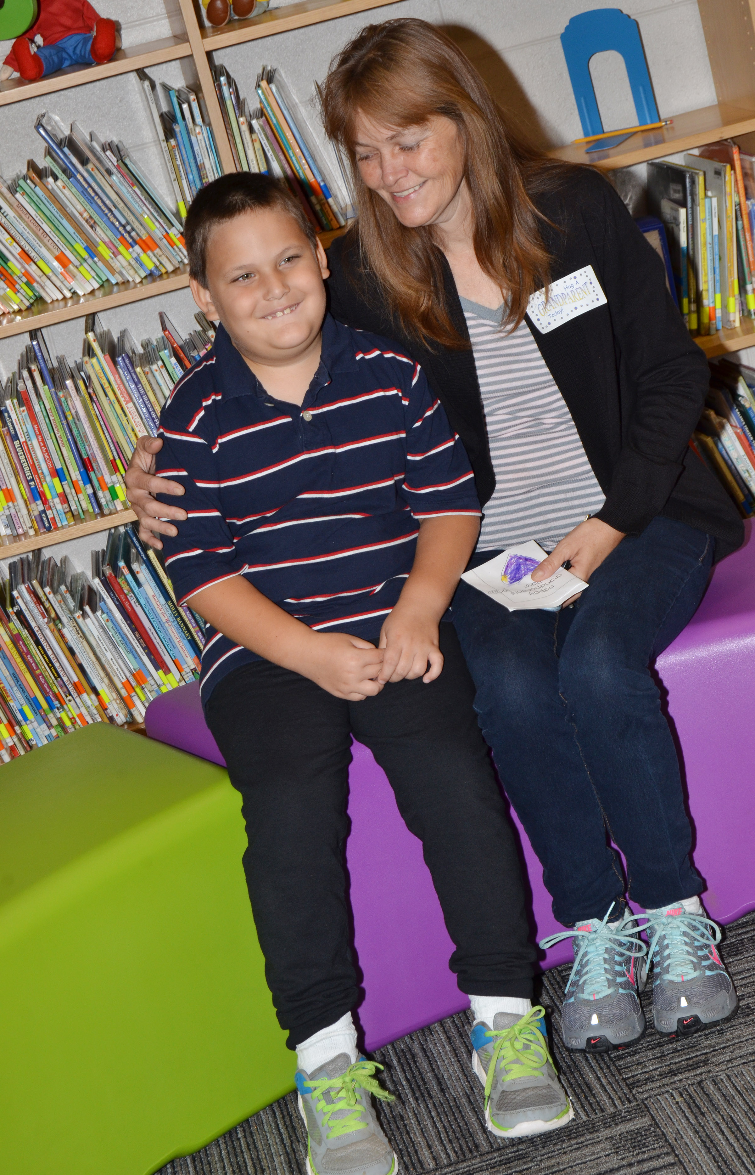 CES first-grader Cloud Malone poses for a photo with his grandmother.