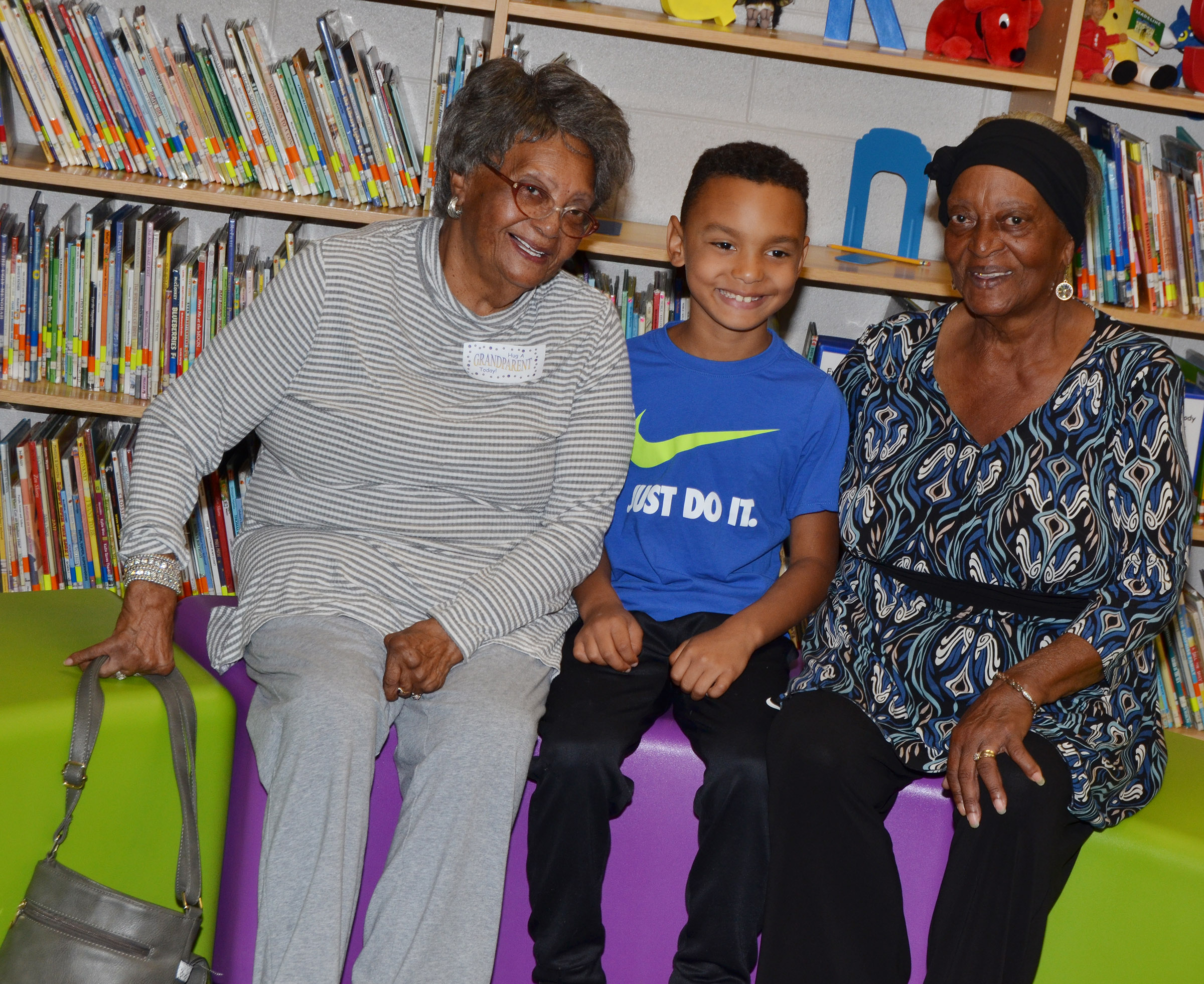 CES third-grader Maddox Hawkins poses for a photo with his grandmothers.