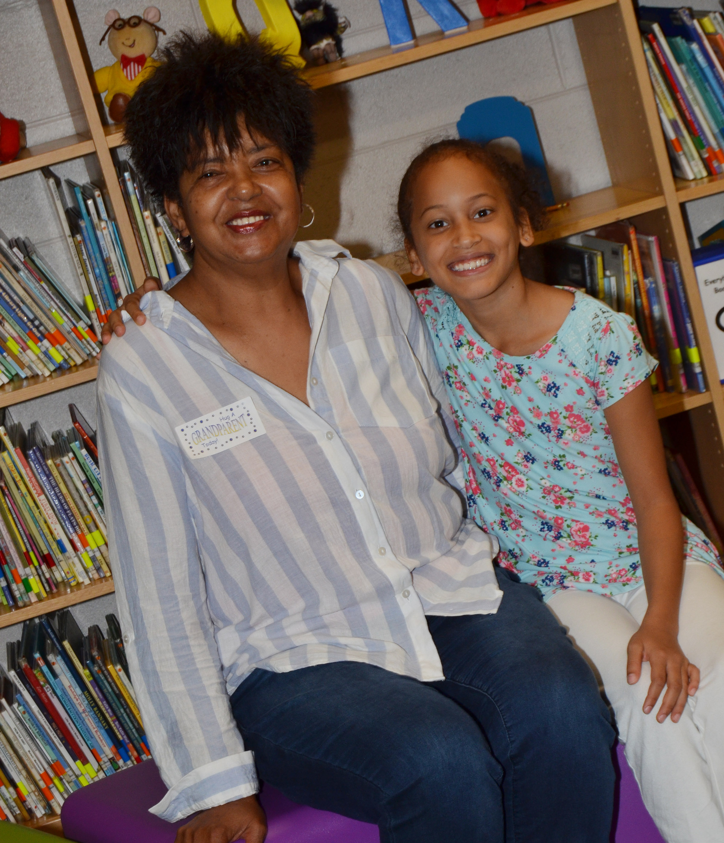 CES third-grader Yazlyn Sutton smiles for a photo with her grandmother.