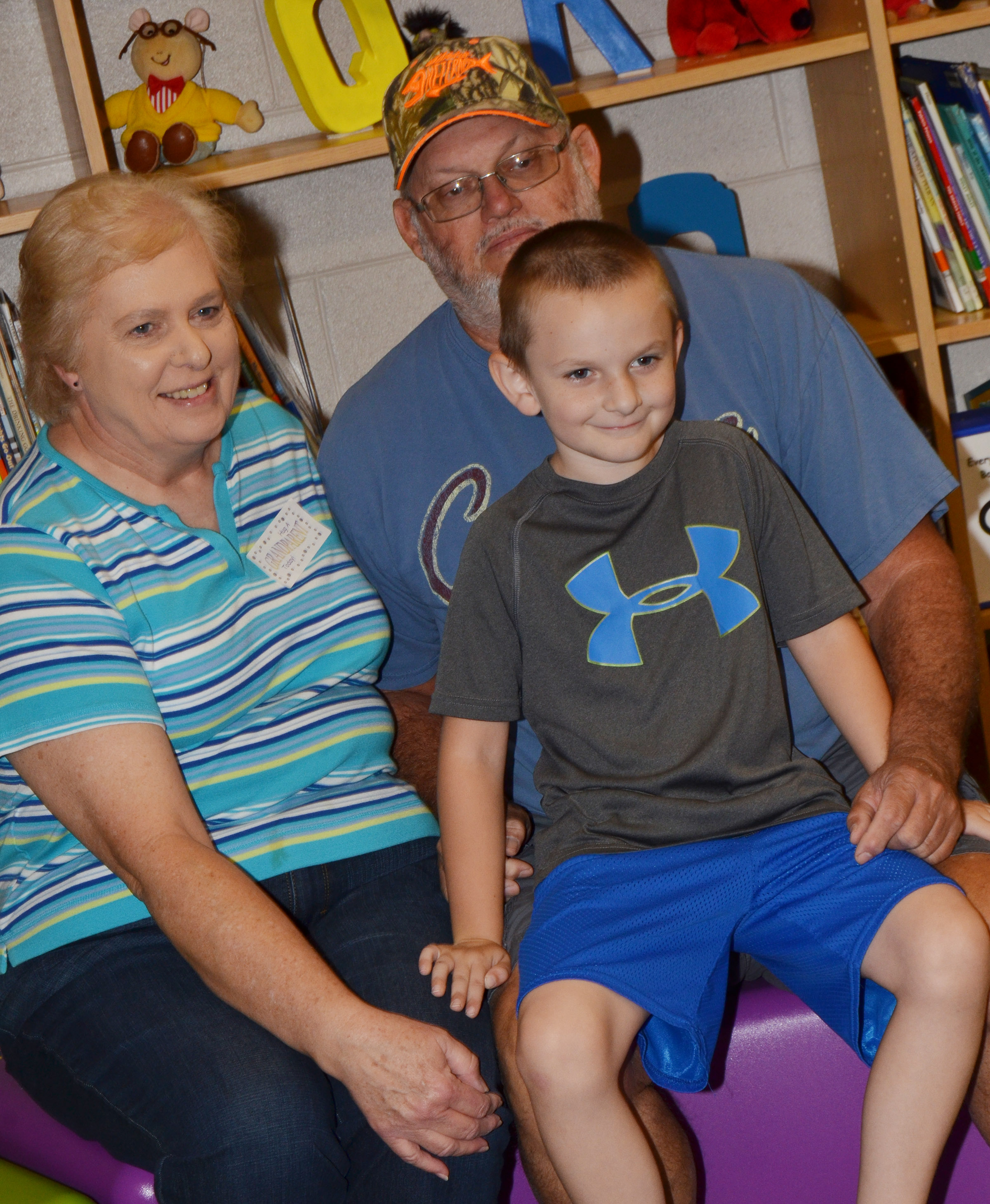 CES first-grader Ryne Gumm poses for a photo with his grandparents.