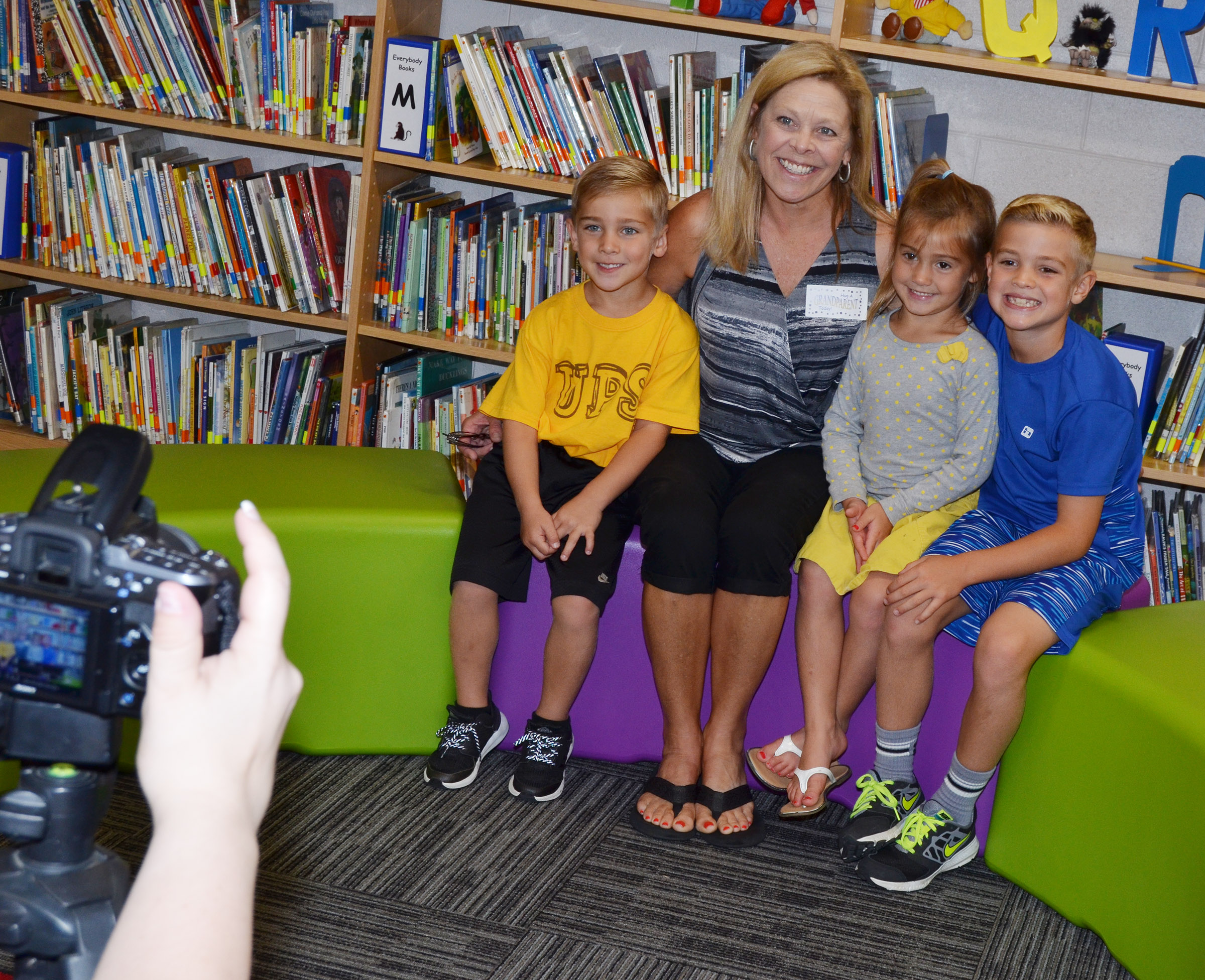 From left, CES kindergarteners Dane Gray and Blakely Gray and second-grader Dax Gray smile for a photo with their grandmother.