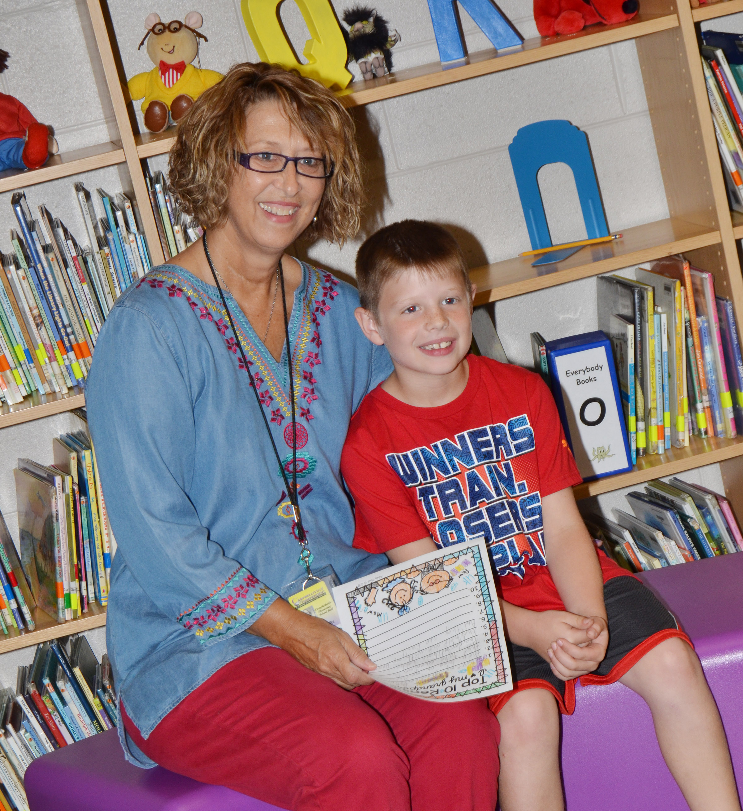 CES second-grader Brody Sidebottom smiles with his grandmother.