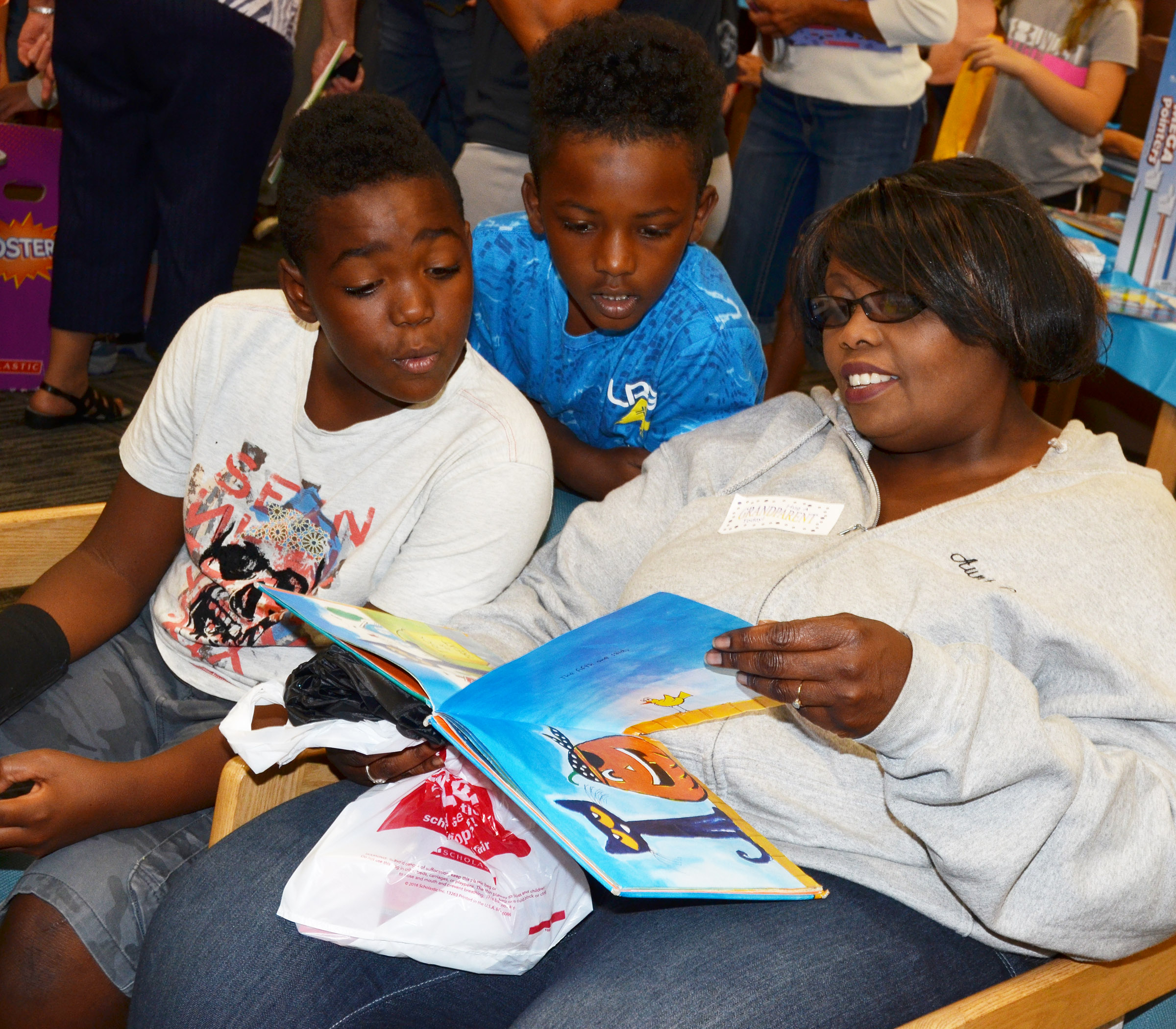 CES fifth-grader Deason Smith, at left, and second-grader Drelynn Hollins read with their grandmother.
