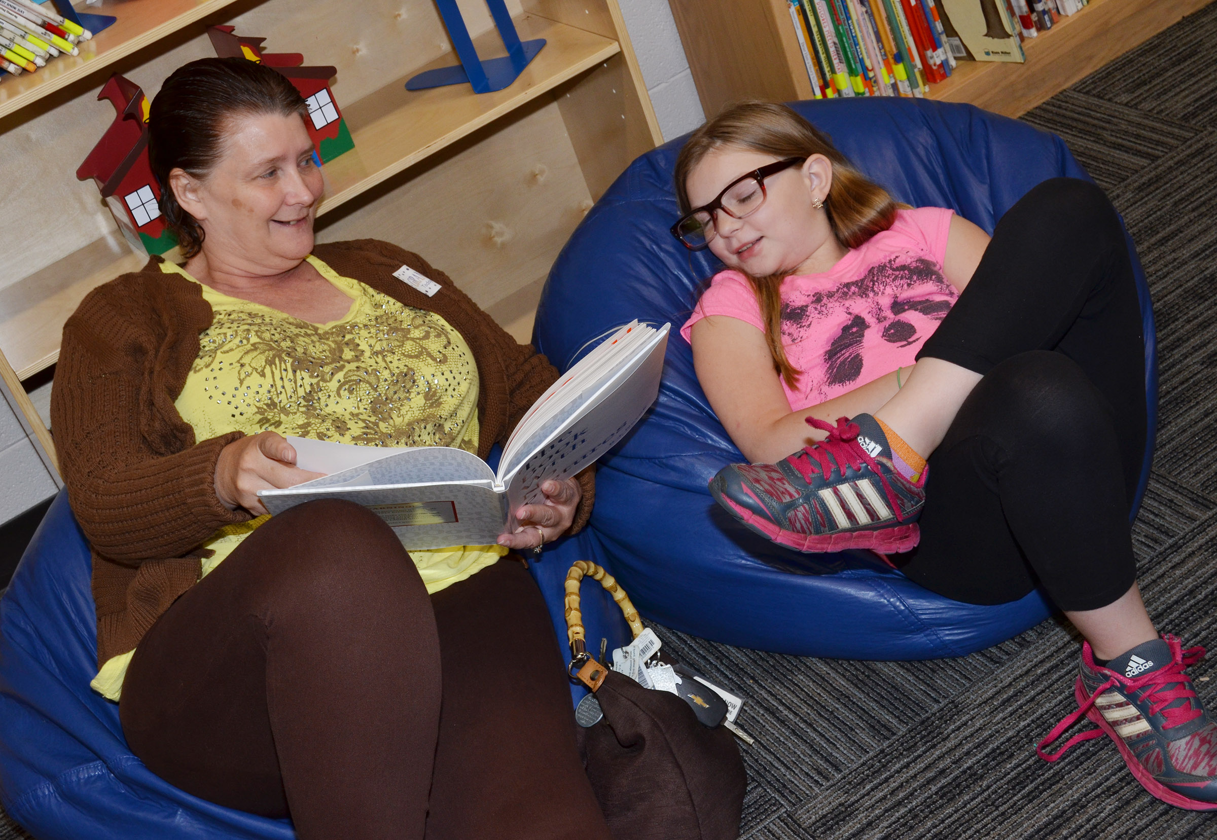 CES fifth-grader Morgan Spears reads with her grandmother.