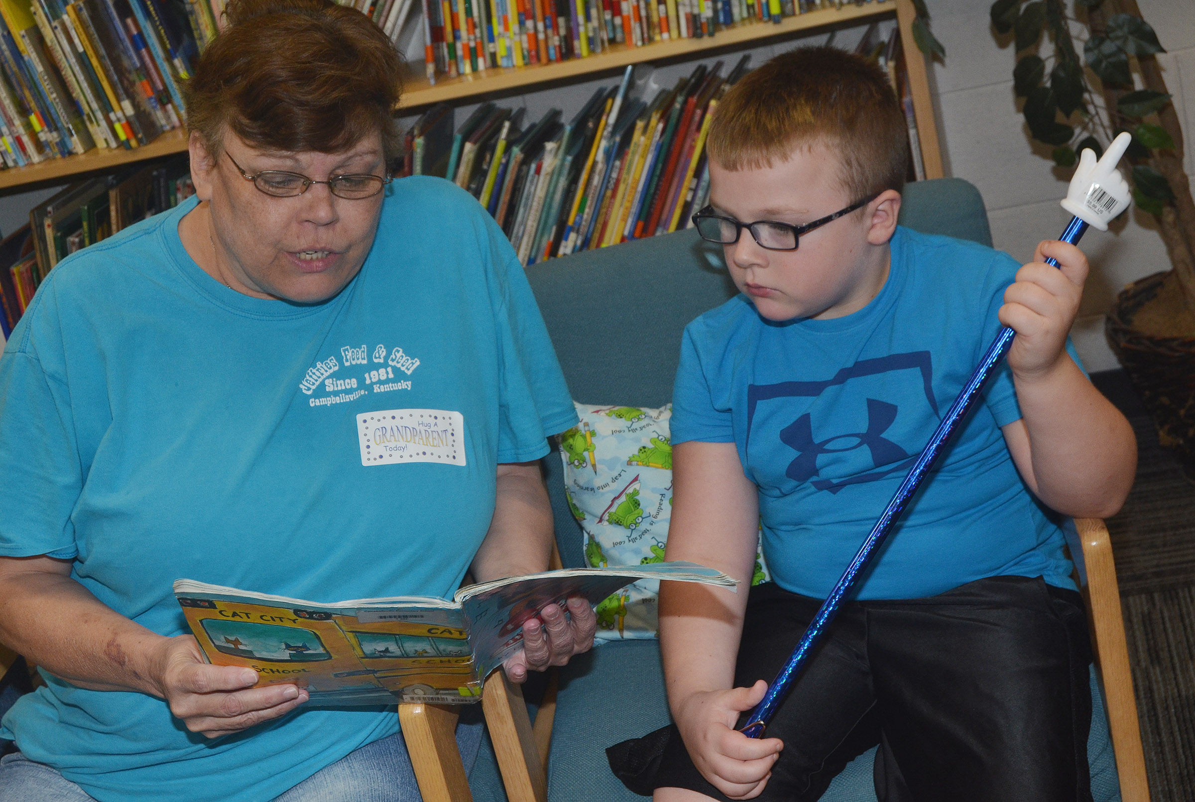 CES second-grader Hunter Clark reads with his grandmother.