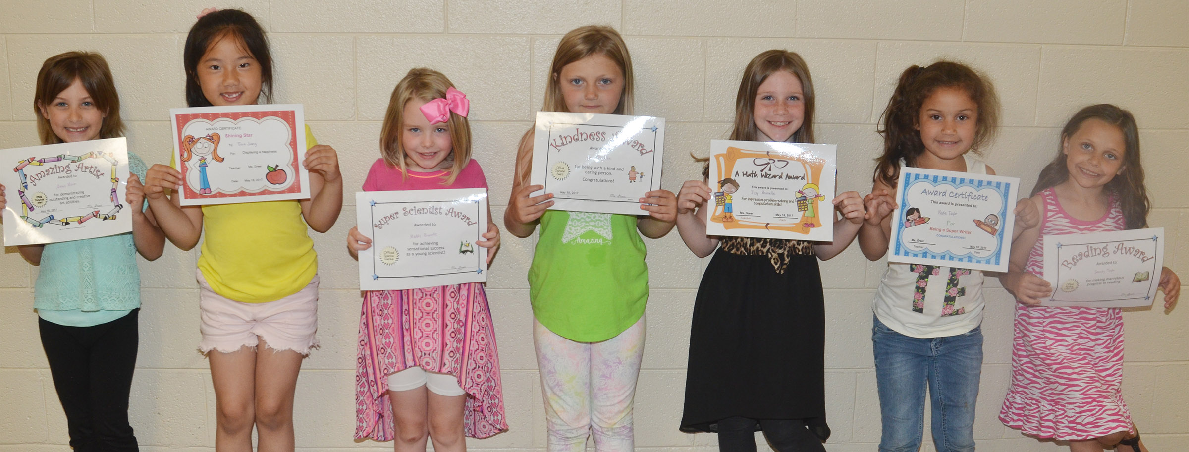 CES first-graders in Amanda Greer's class recently received awards for their academic work and classroom behavior this school year. From left are Alexis Mann, Tina Jiang, Maddie Brunelle, Asia Singleton, Izzy Brunelle, Nadia Taylor and Serenity Taylor.