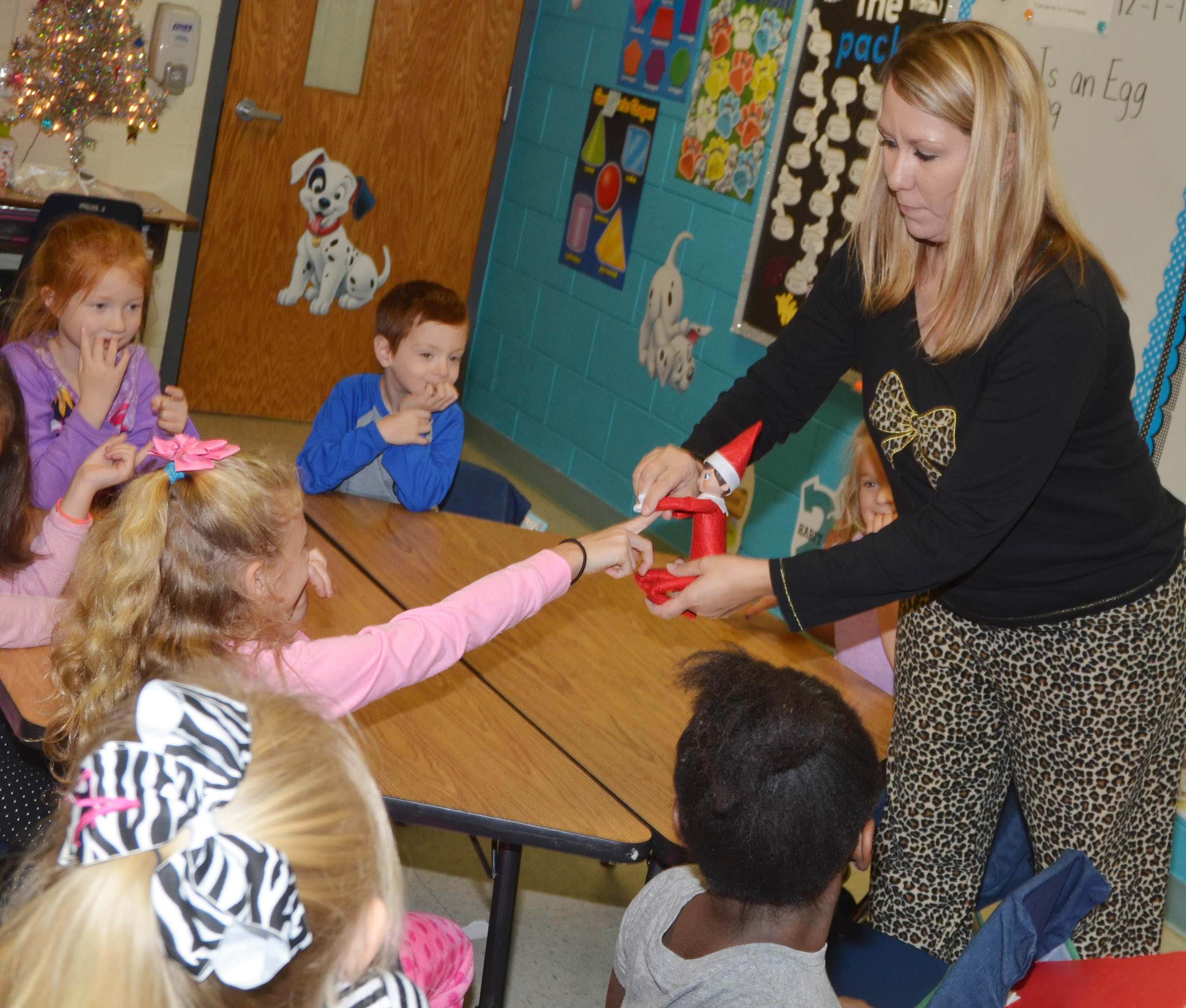 CES second-grade teacher Amanda Greer introduces the class elf to Aliyah Litsey.