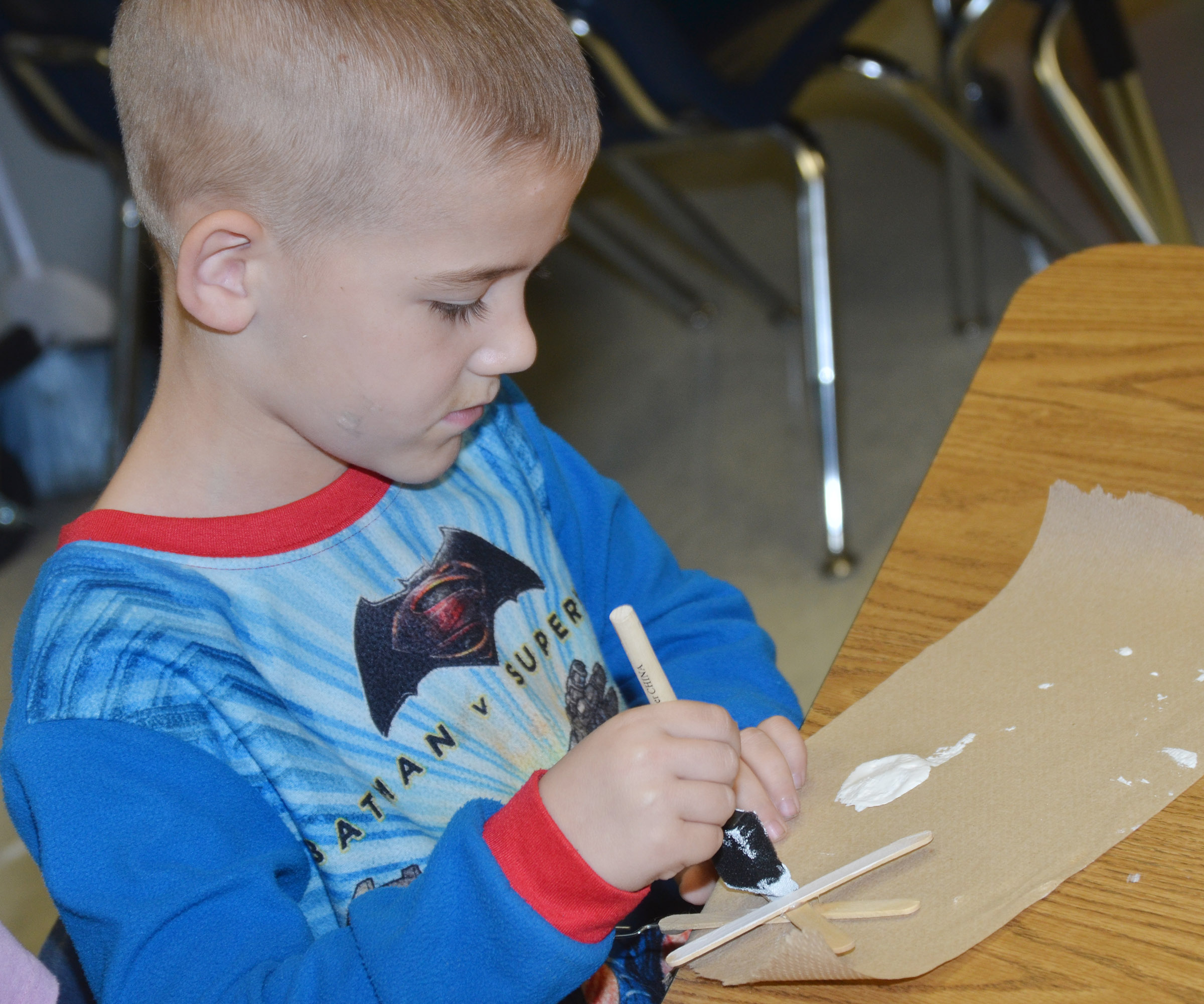 CES second-grader Mason Edwards paints his snowflake ornament.
