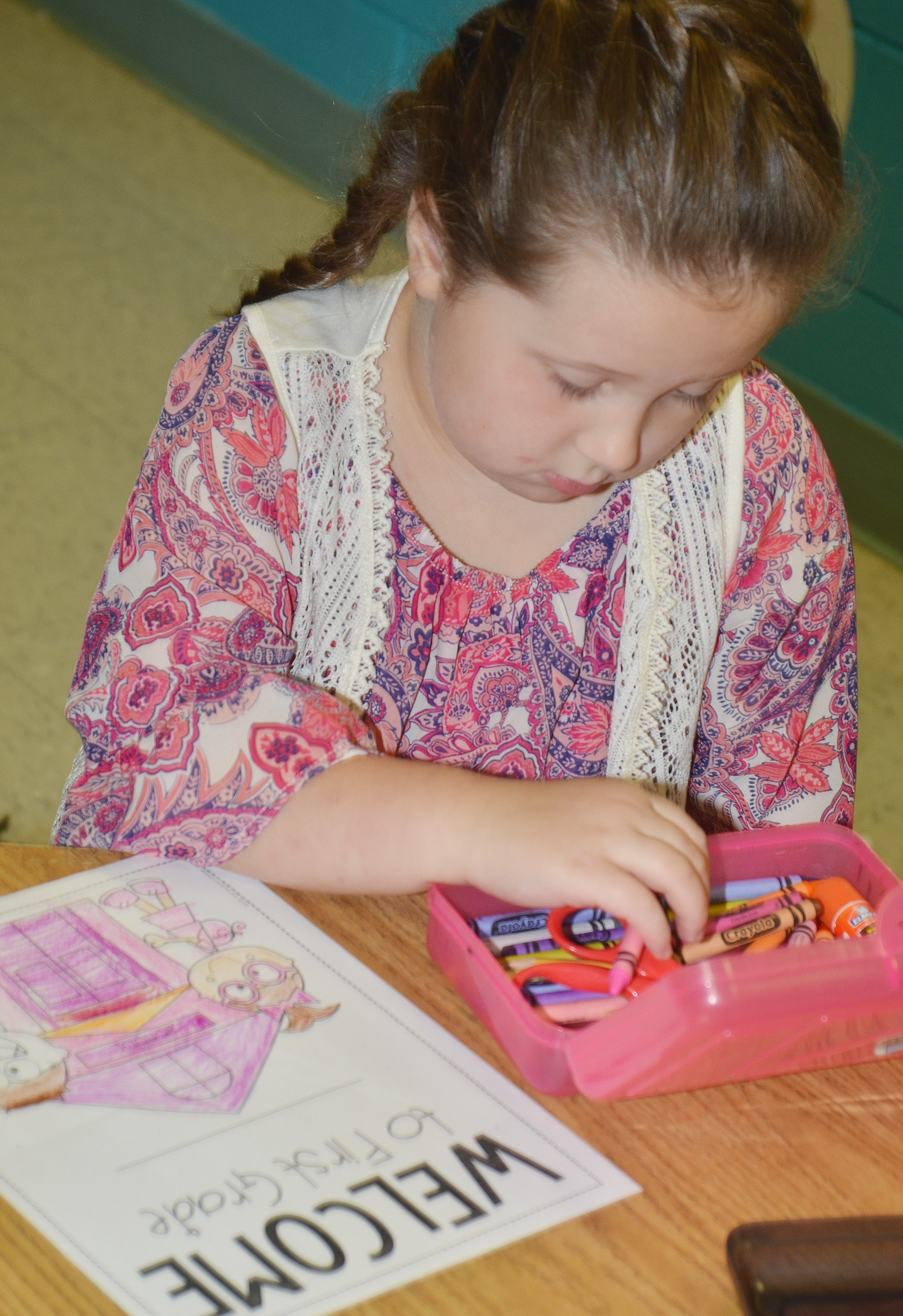 CES first-grader Mikaylah Flynn looks for a crayon.