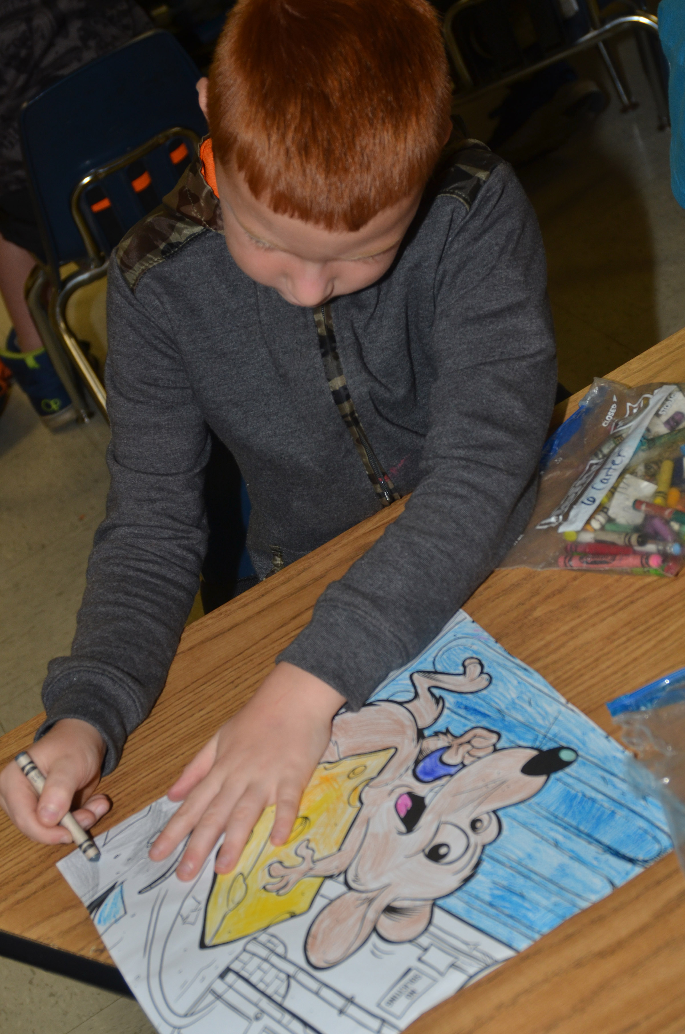 CES first-grader Carter Wethington colors.