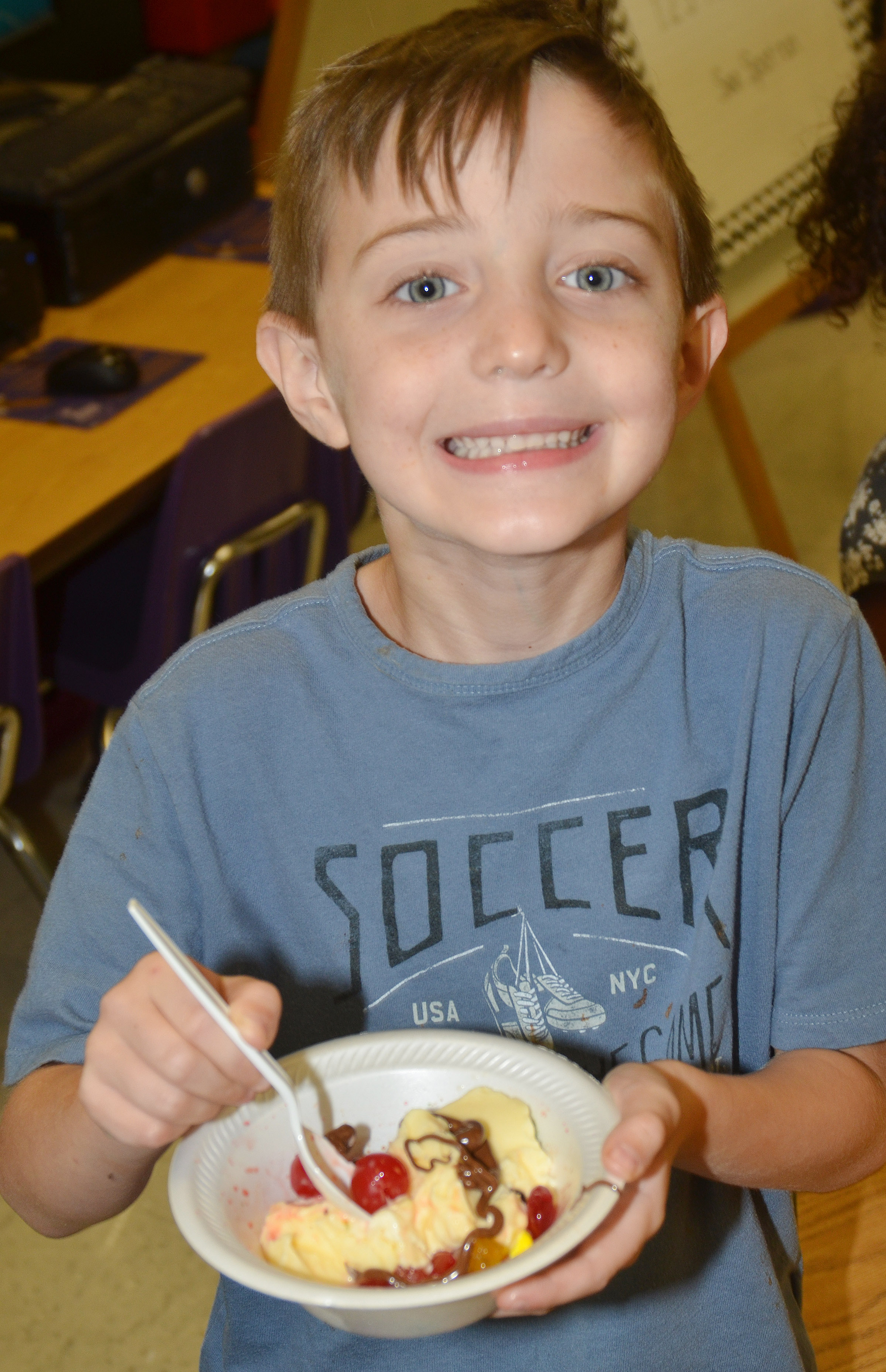 CES first-grader Caleb Goodson enjoys his ice cream sundae.