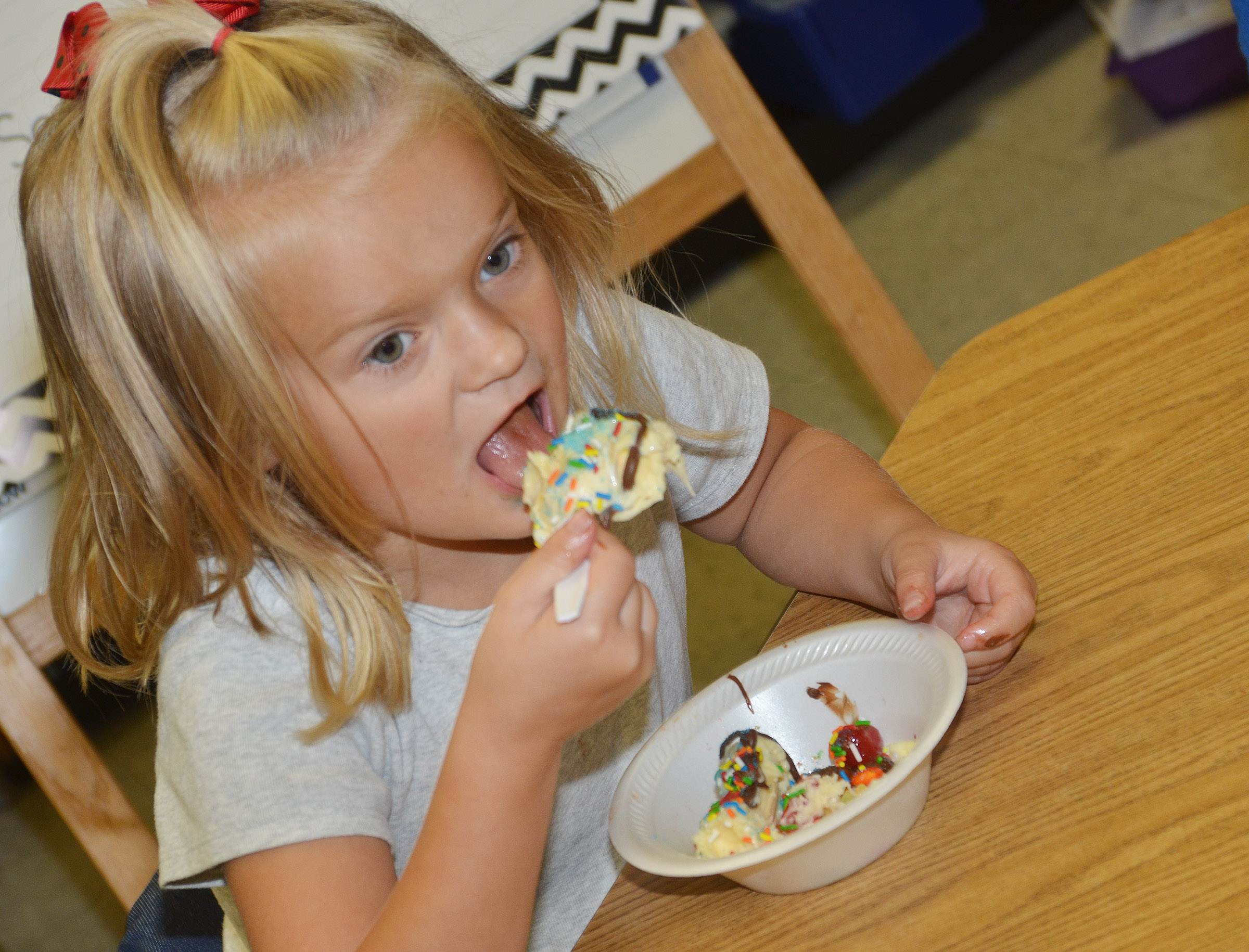 CES first-grader Miley Orberson enjoys her ice cream sundae.