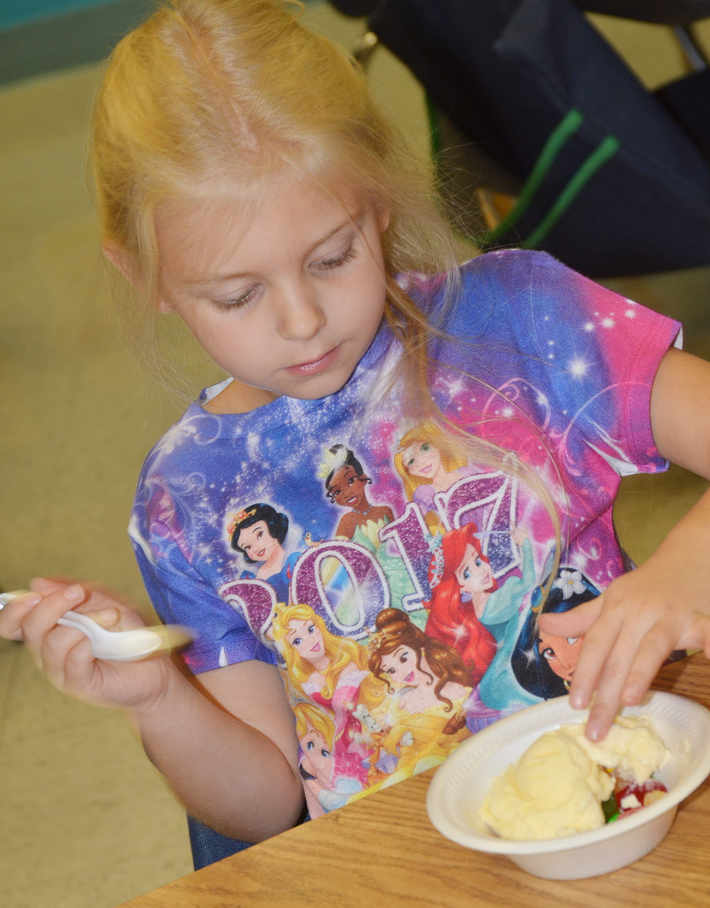 CES first-grader Aubrey Novak eats her ice cream sundae.
