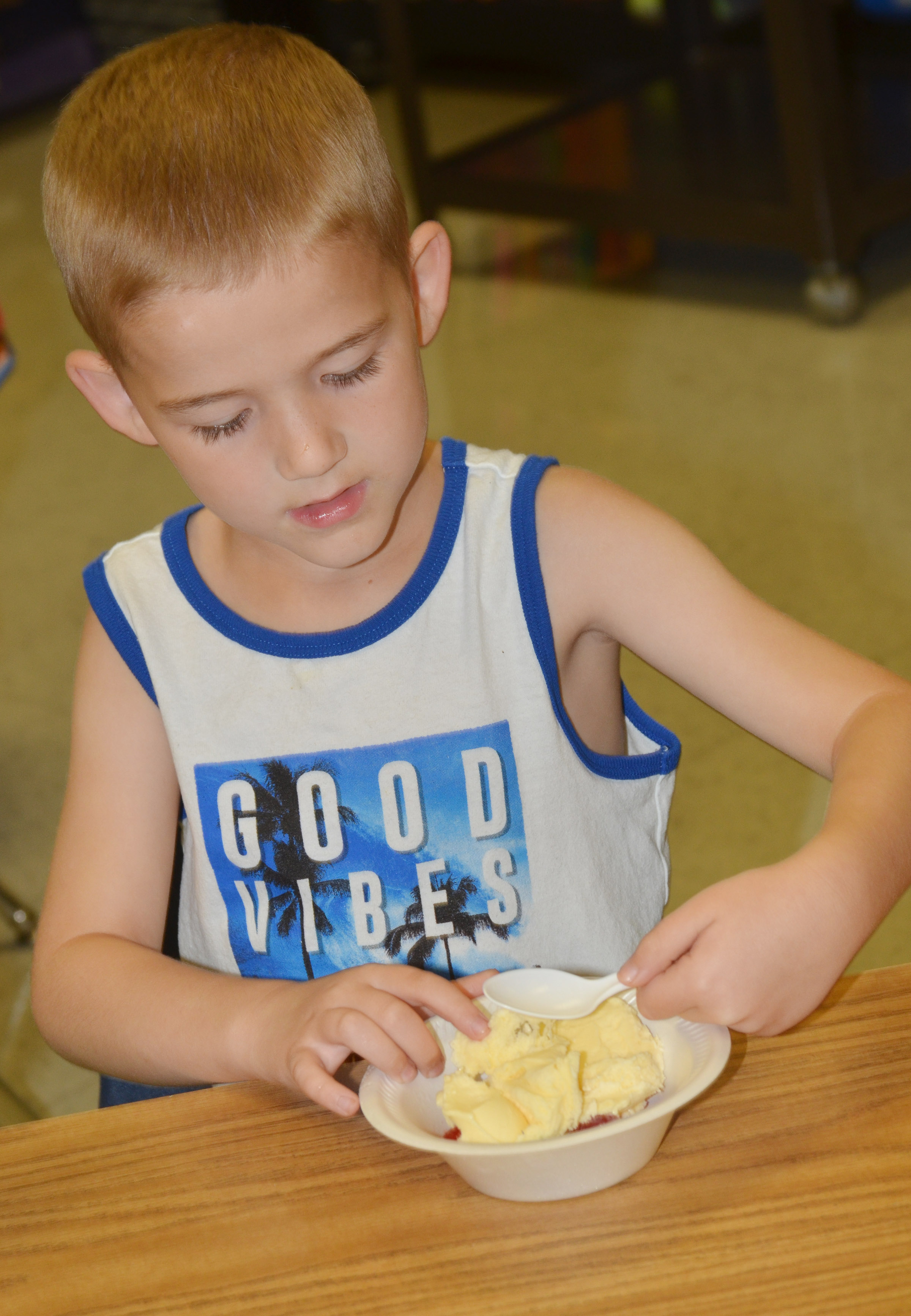 CES first-grader Mason Edwards enjoys his ice cream.