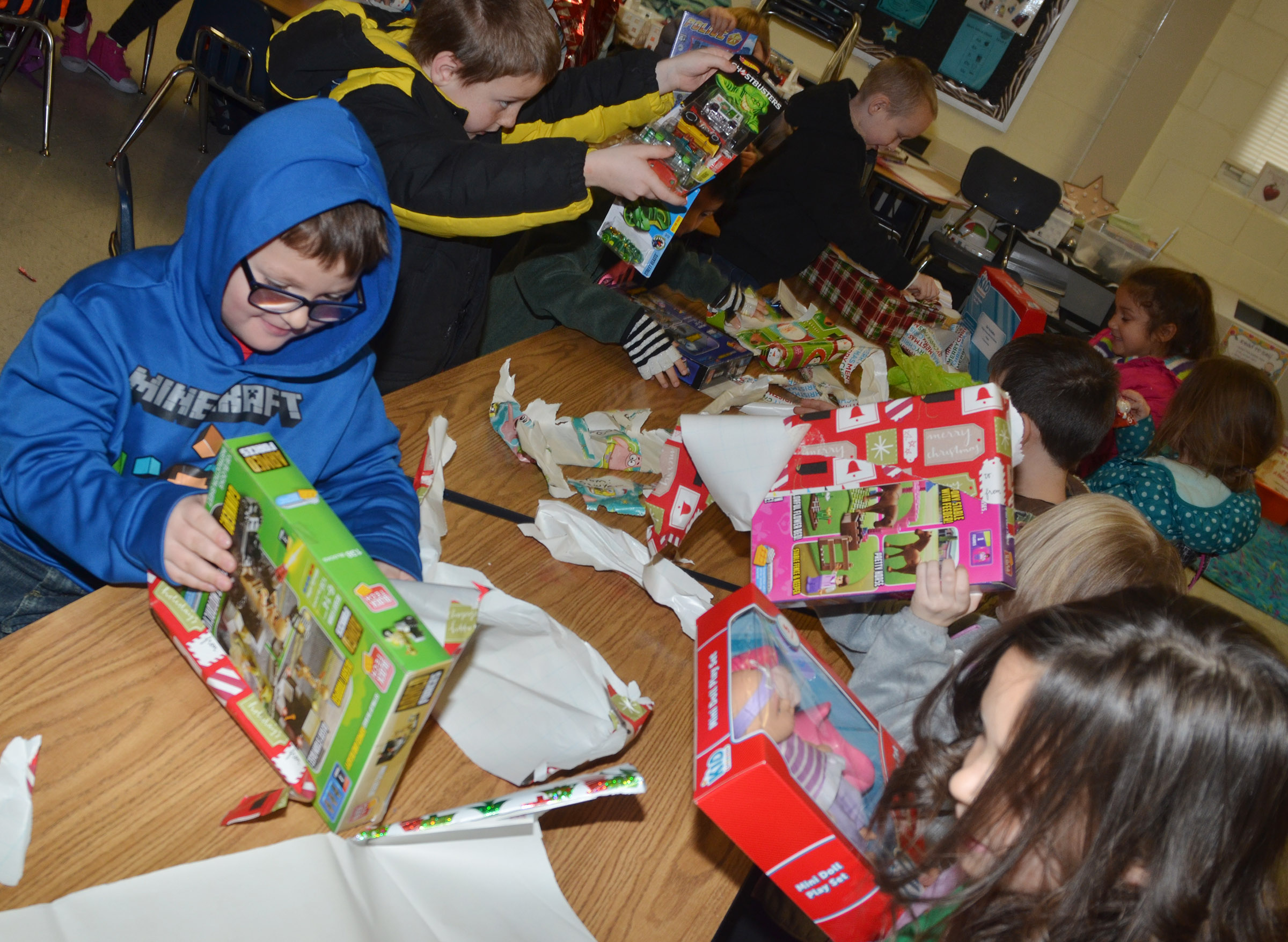 CES first-graders open their gifts during their class gift exchange.