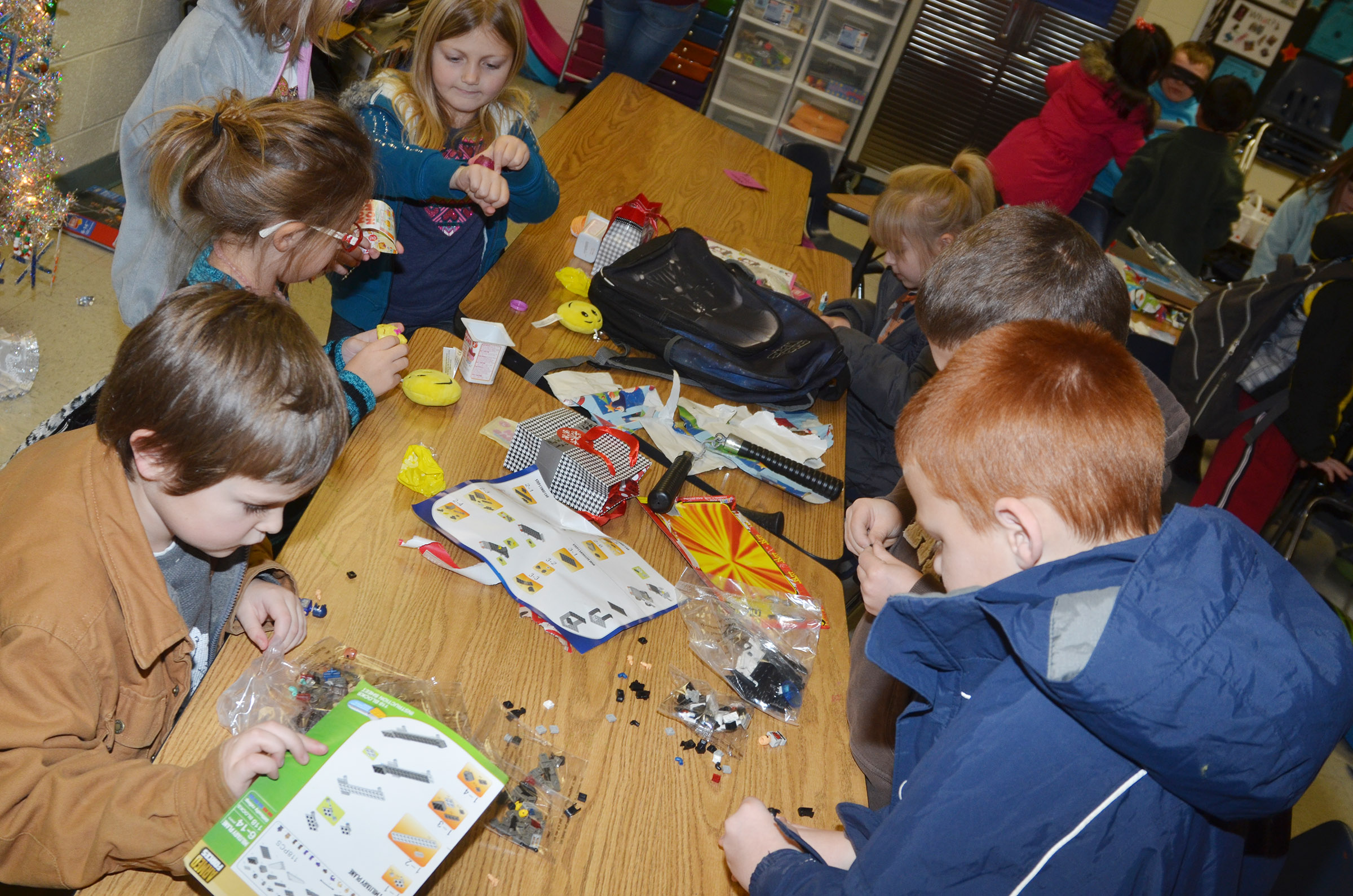 CES first-graders play with the toys they received in their class gift exchange.