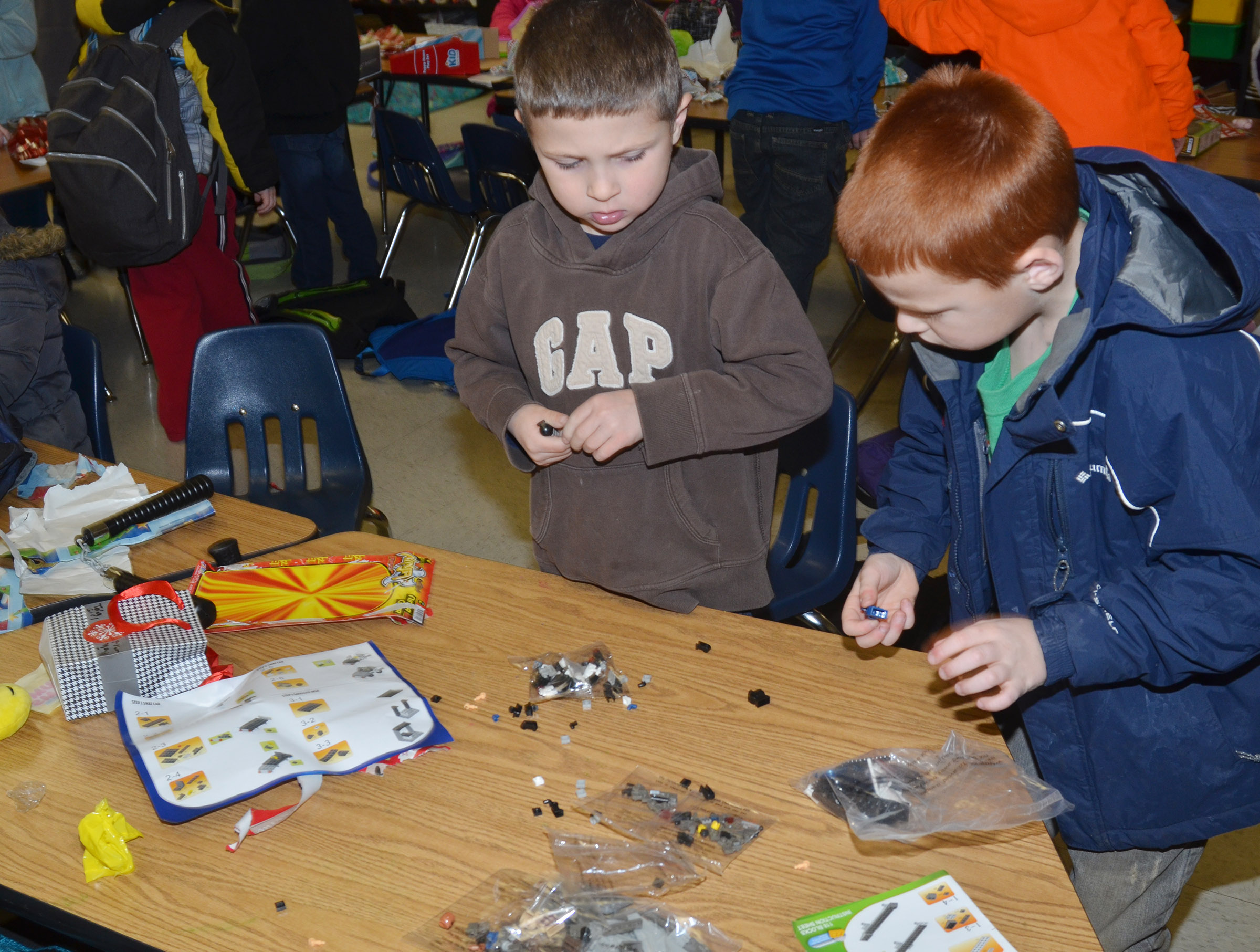 CES first-graders Bryson Gabehart, at left, and Carter Wethington play with the toys they received.