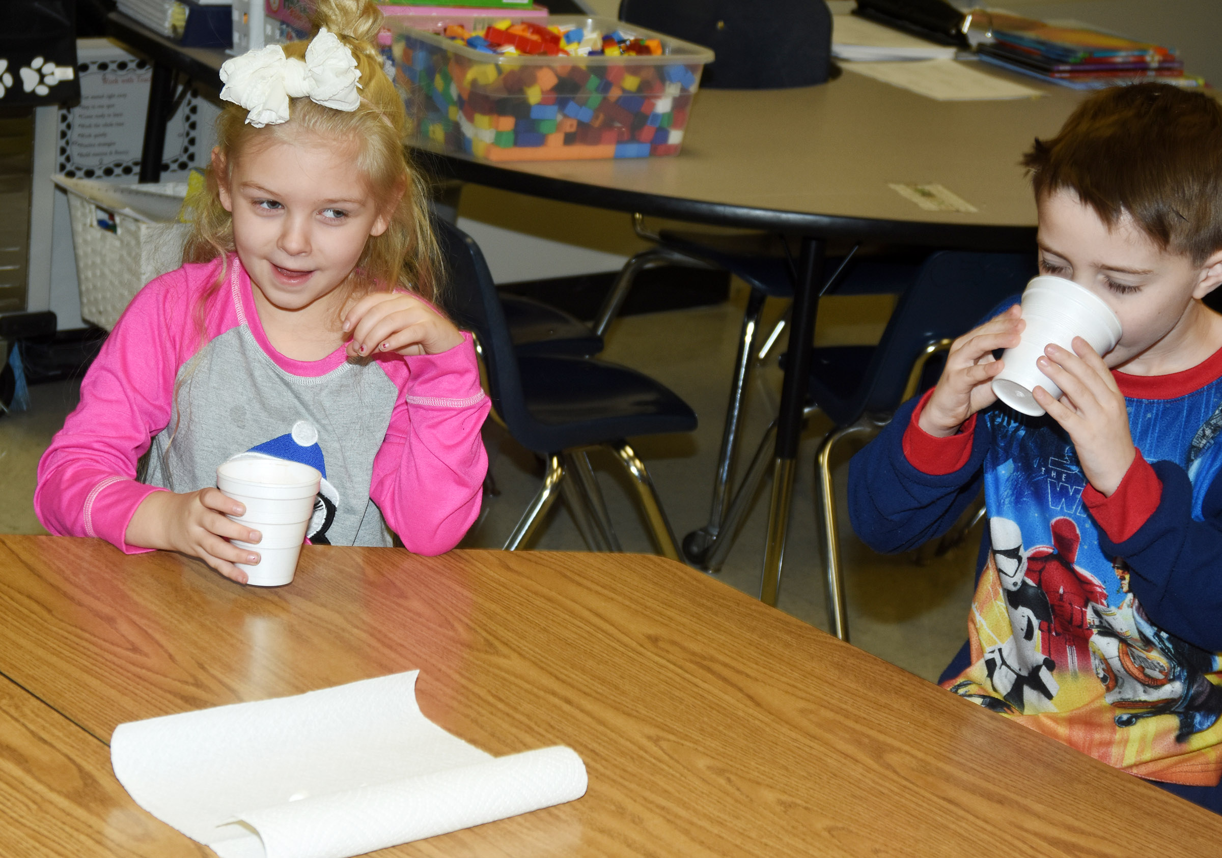 CES first-graders Aubrey Novak, at left, and Caleb Goodson try their hot chocolate.