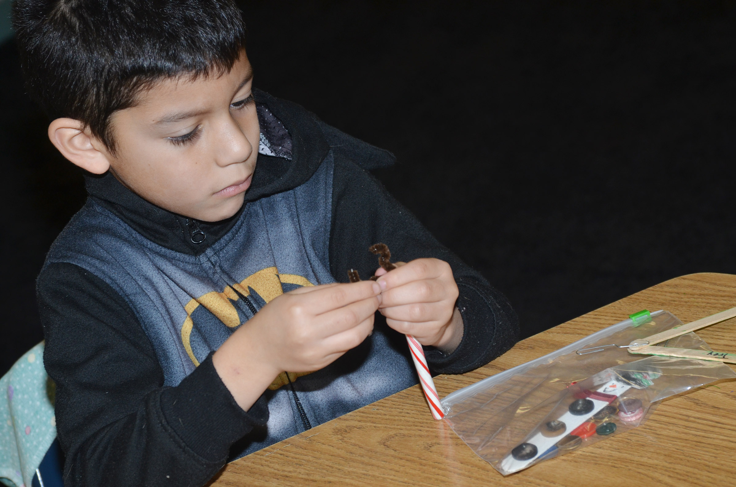 CES first-grader Trey Guajardo adds antlers to his candy cane ornament.