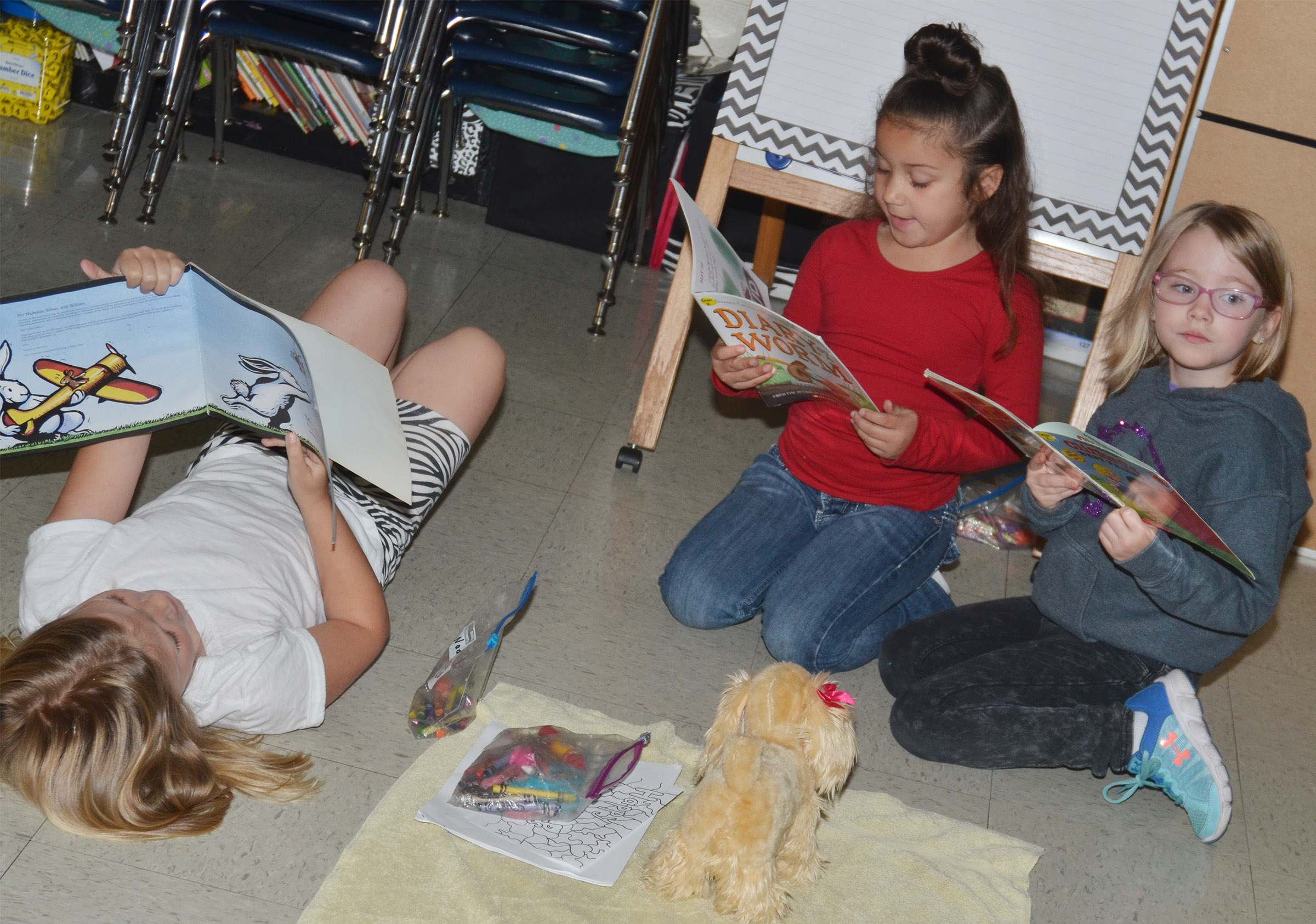 From left, CES first-graders Asia Singleton, Nadia Taylor and Maddie Brunelle read together.