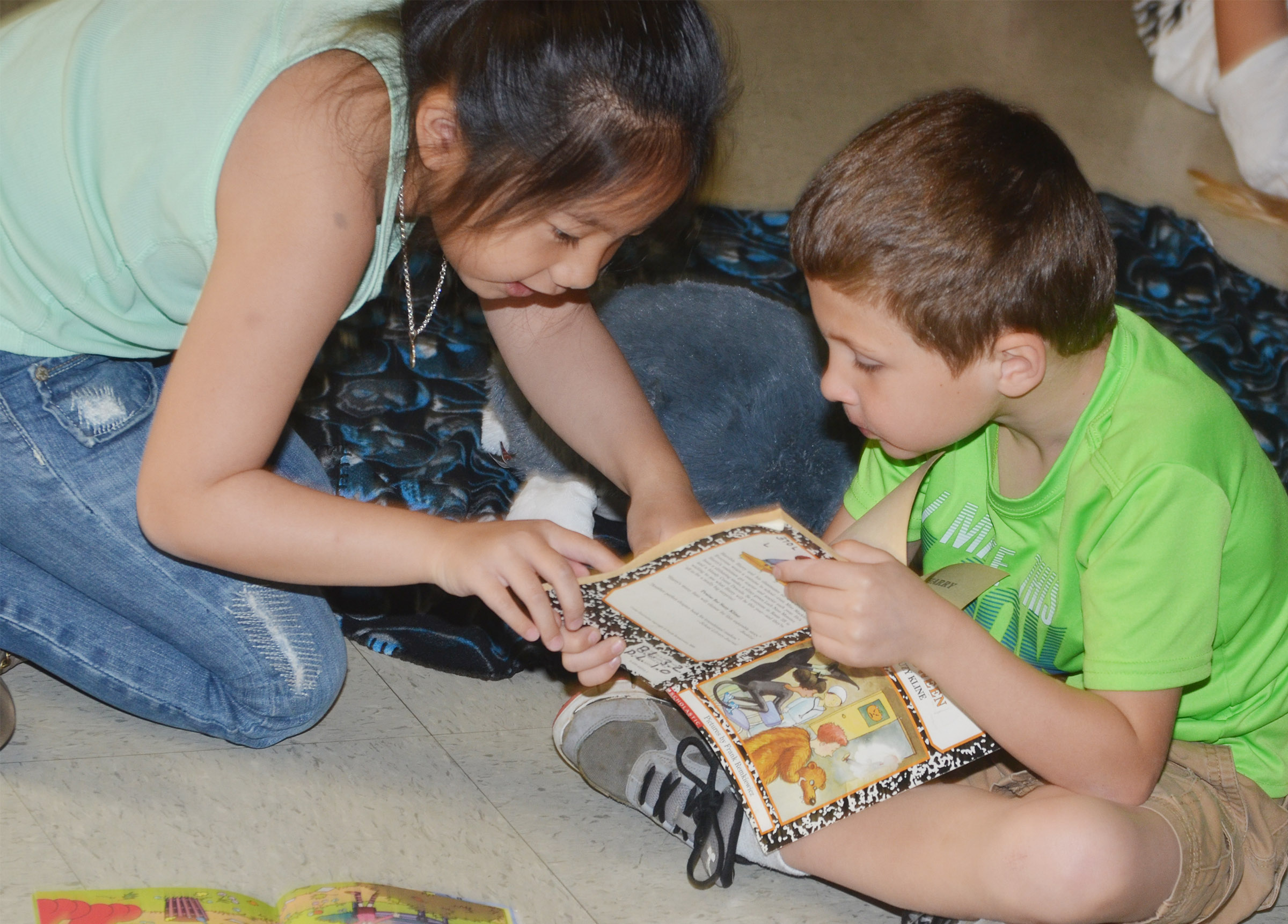CES first-graders Tina Jiang, at left, and Bryson Gabehart read together.