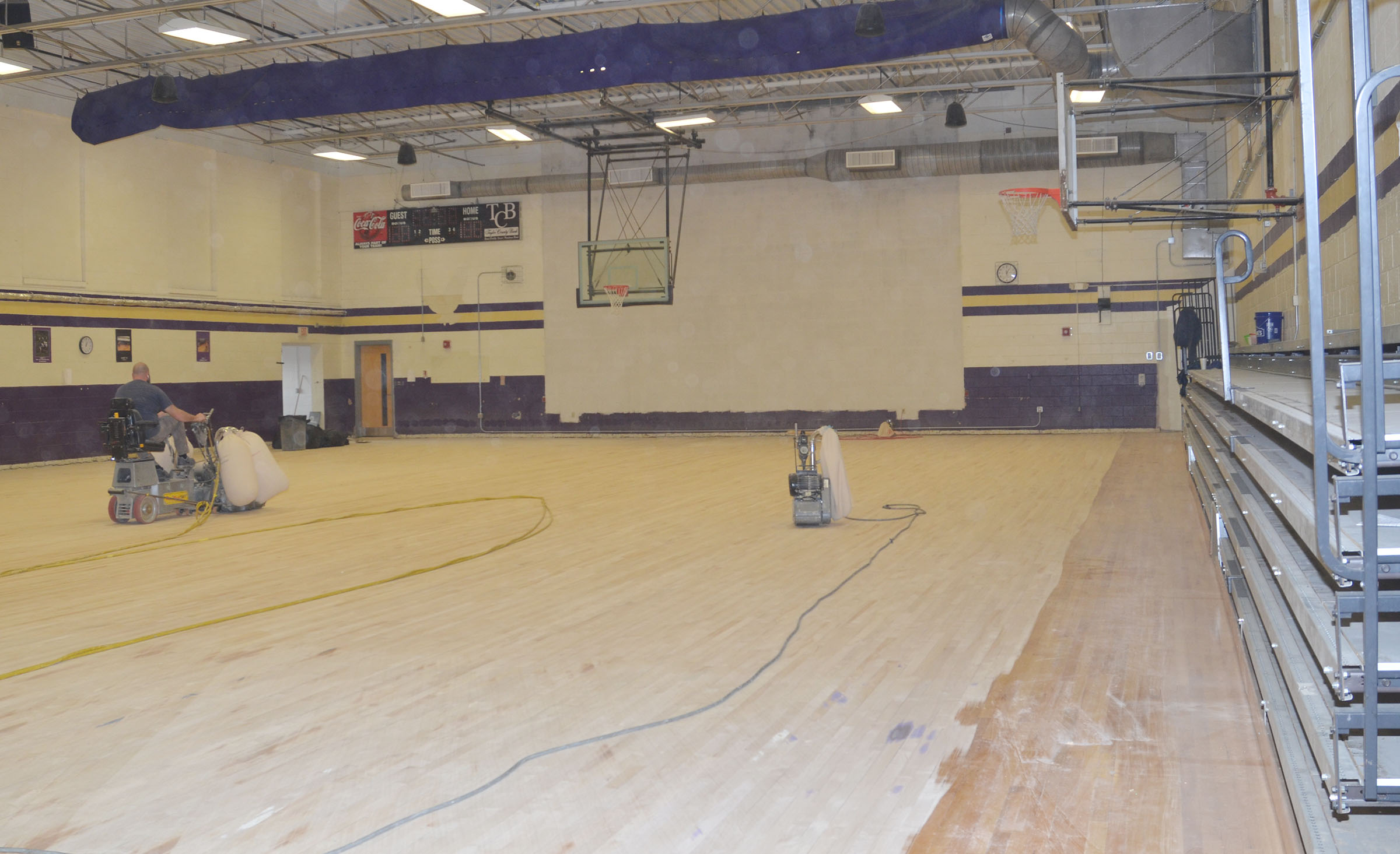 Workers have sanded the CES gym floor and refinished it.