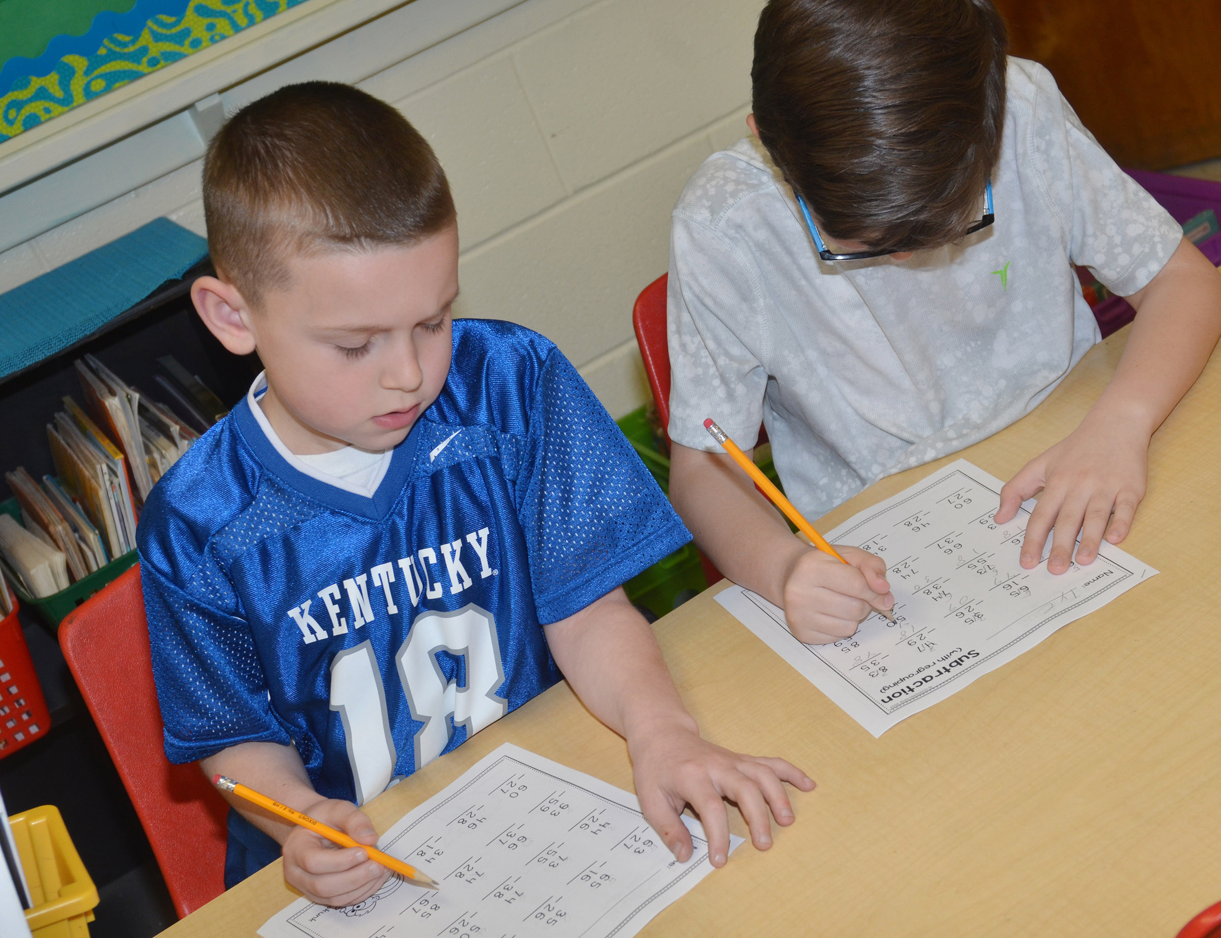 CES second-grader Greyson Montgomery, at left, and Tye Rhodes work subtraction problems.