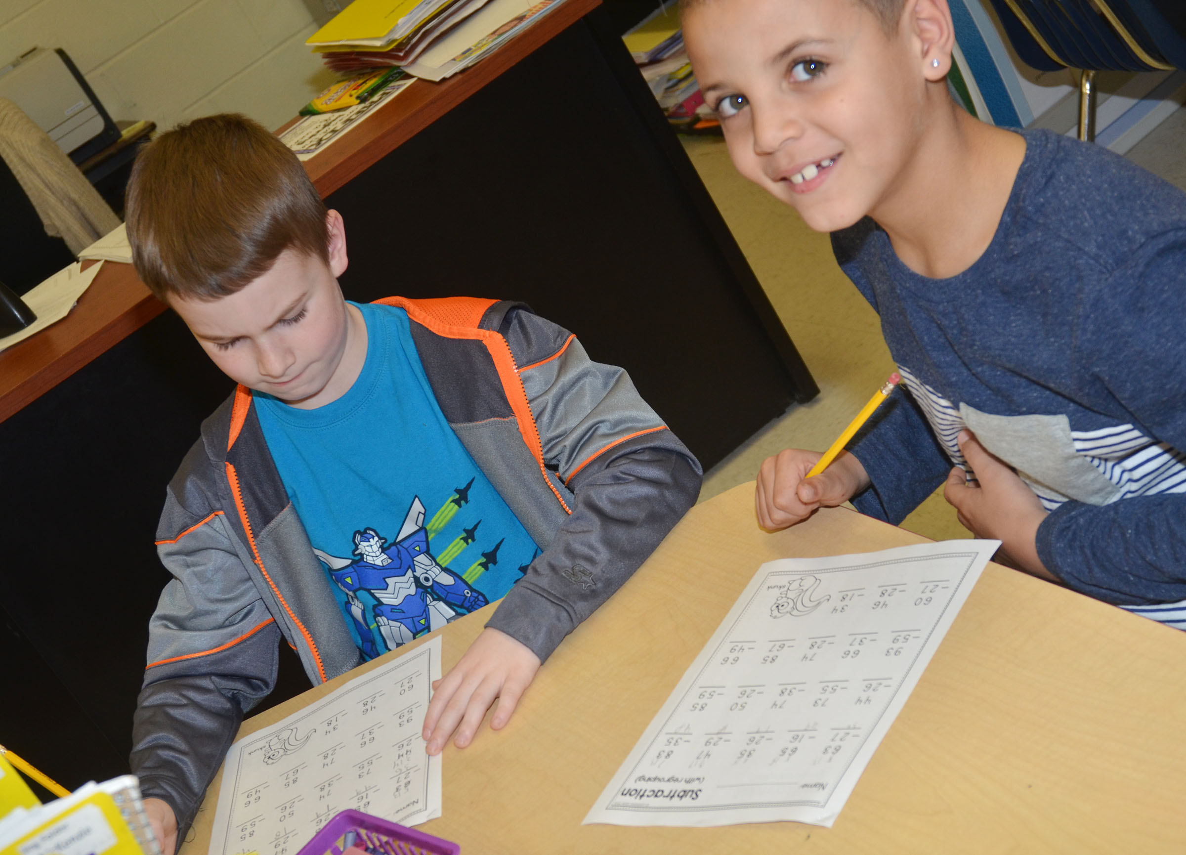CES second-graders Stephen Green, at left, and Zayden McKenzie work subtraction problems.