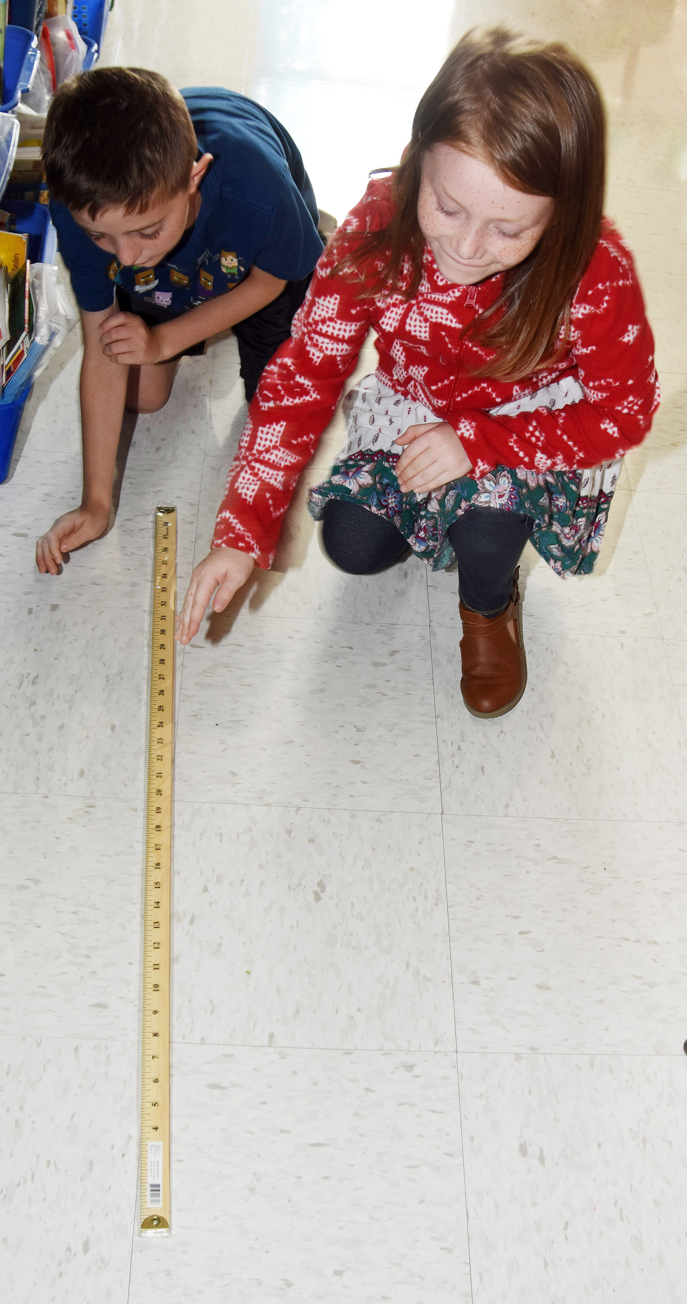 CES second-graders Caleb Goodson, at left, and Emma Humphress practice measuring.