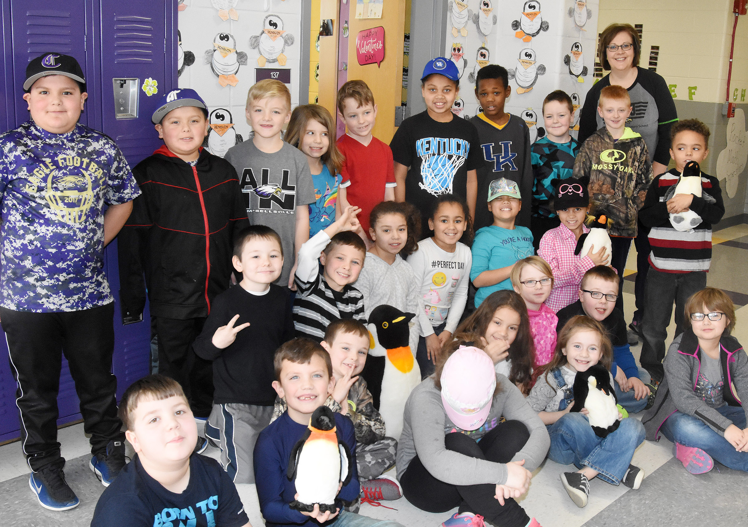CES second-graders in Tonya Hagan's class are learning all about penguins. Hagan recently brought several stuffed penguins to school to keep her students company as they wrote essays about the animals.