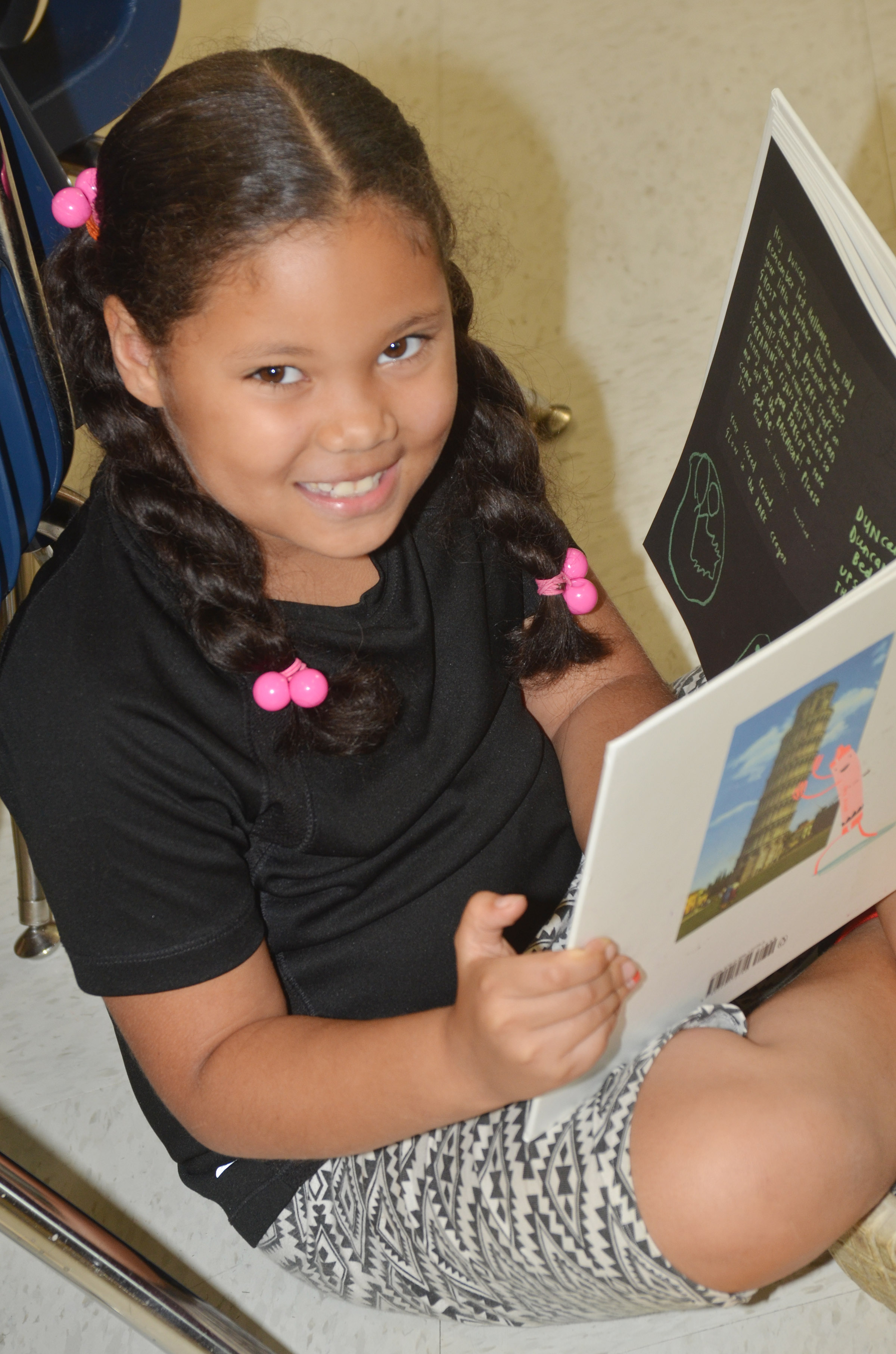CES second-grader Briana Wooley smiles as she reads.