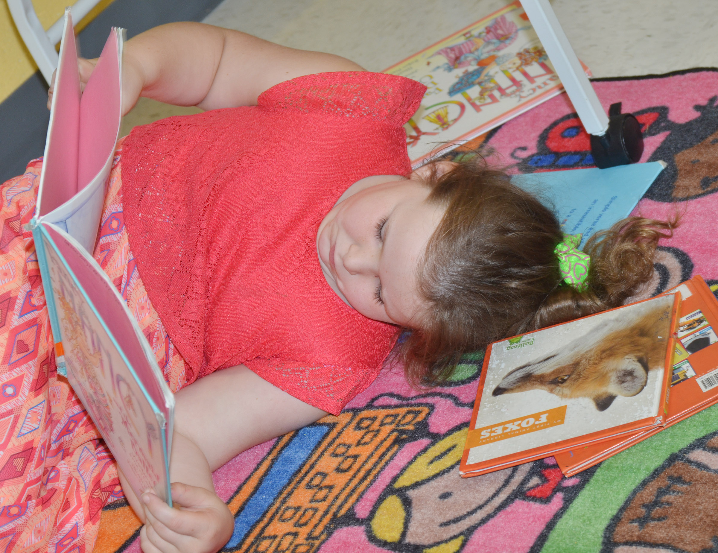 CES second-grader Kierra Maupin lays down to read.